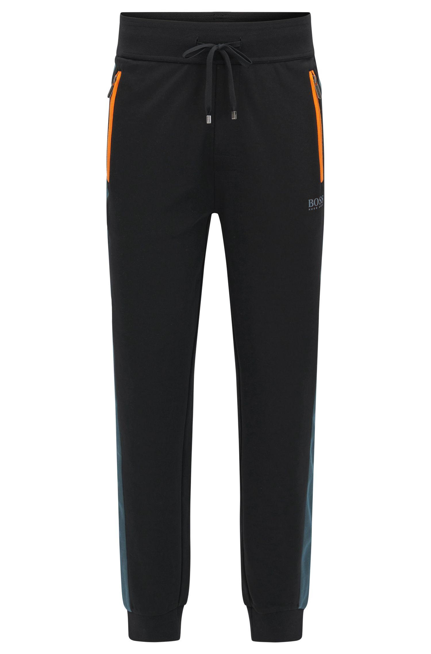 Pantalones de chándal con tejido de piqué en mezcla de algodón con detalles en contraste
