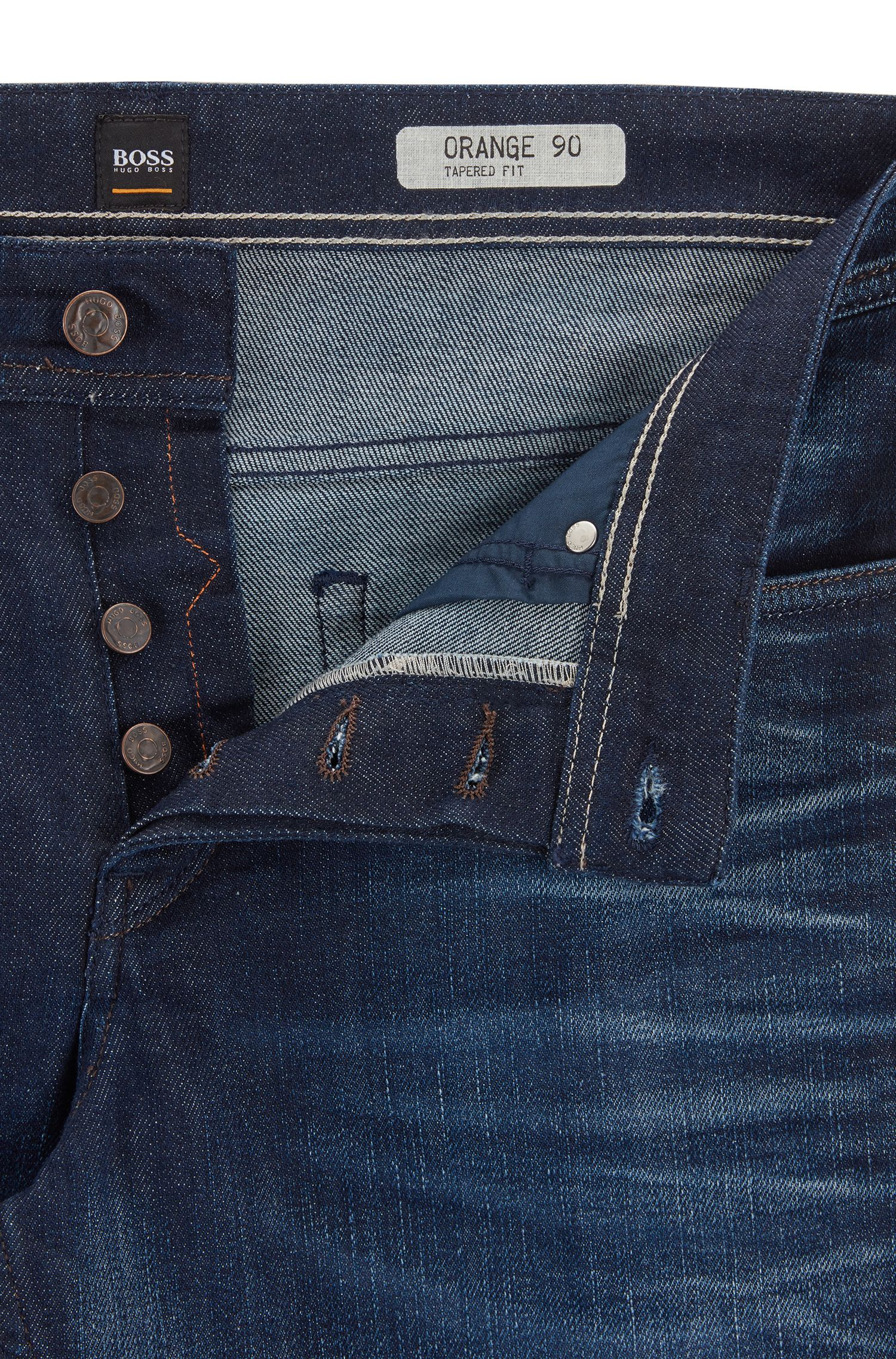 Vaqueros tapered fit en denim elástico para mayor confort