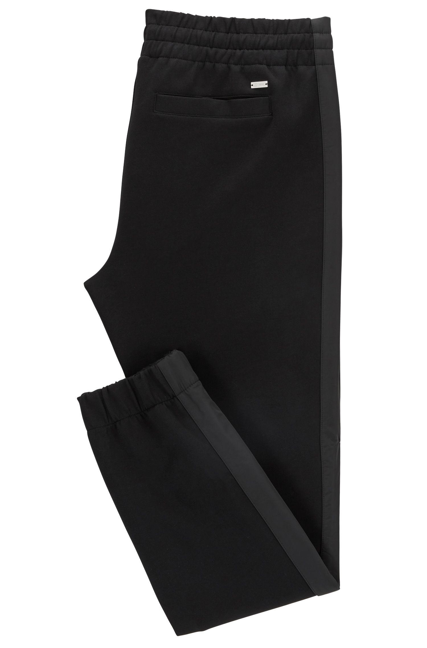 Pantalon Slim Fit en jersey resserré au bas des jambes Mercedes-Benz