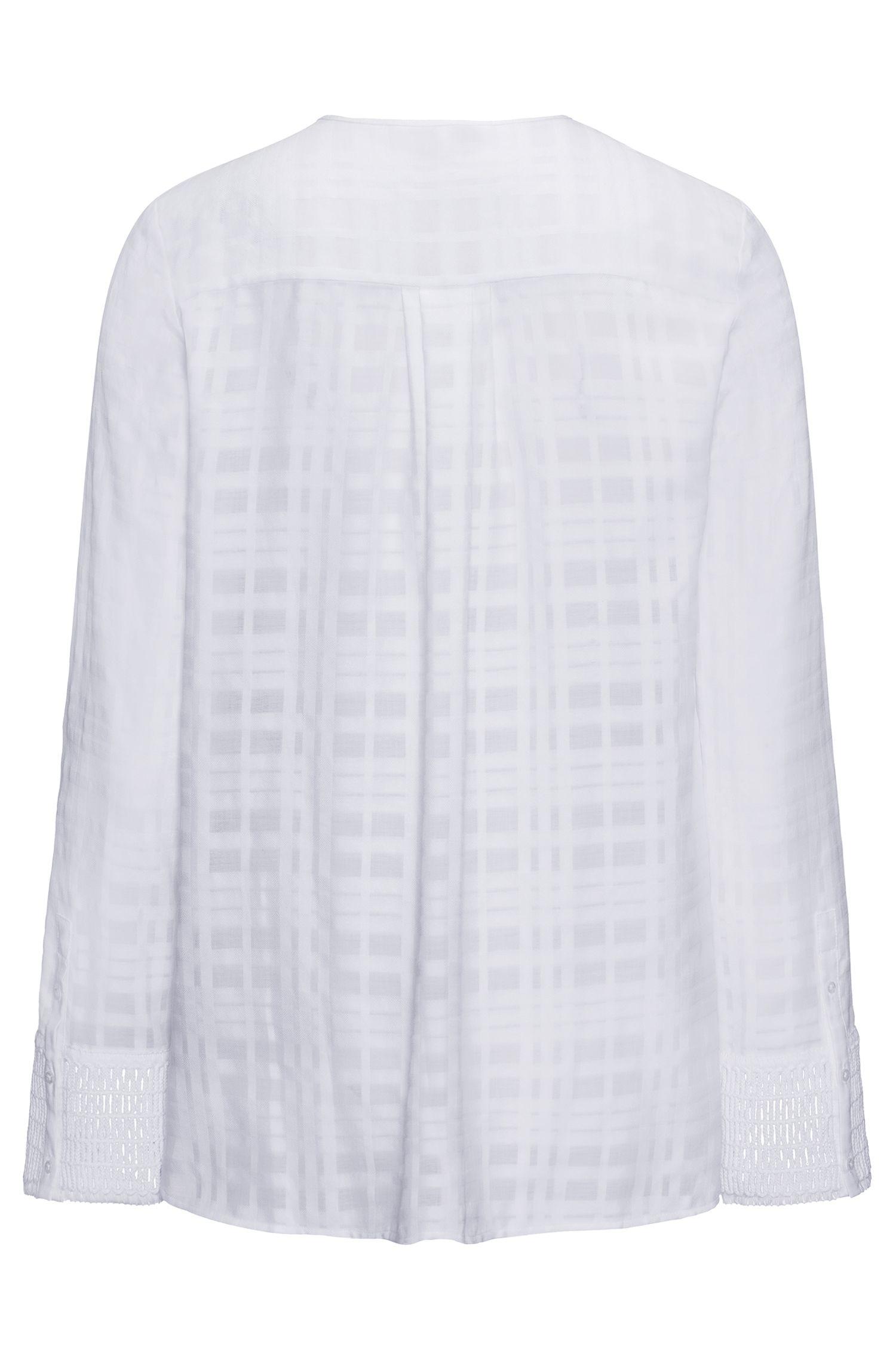Blusa de algodón sin cuello con detalles de macramé en los puños