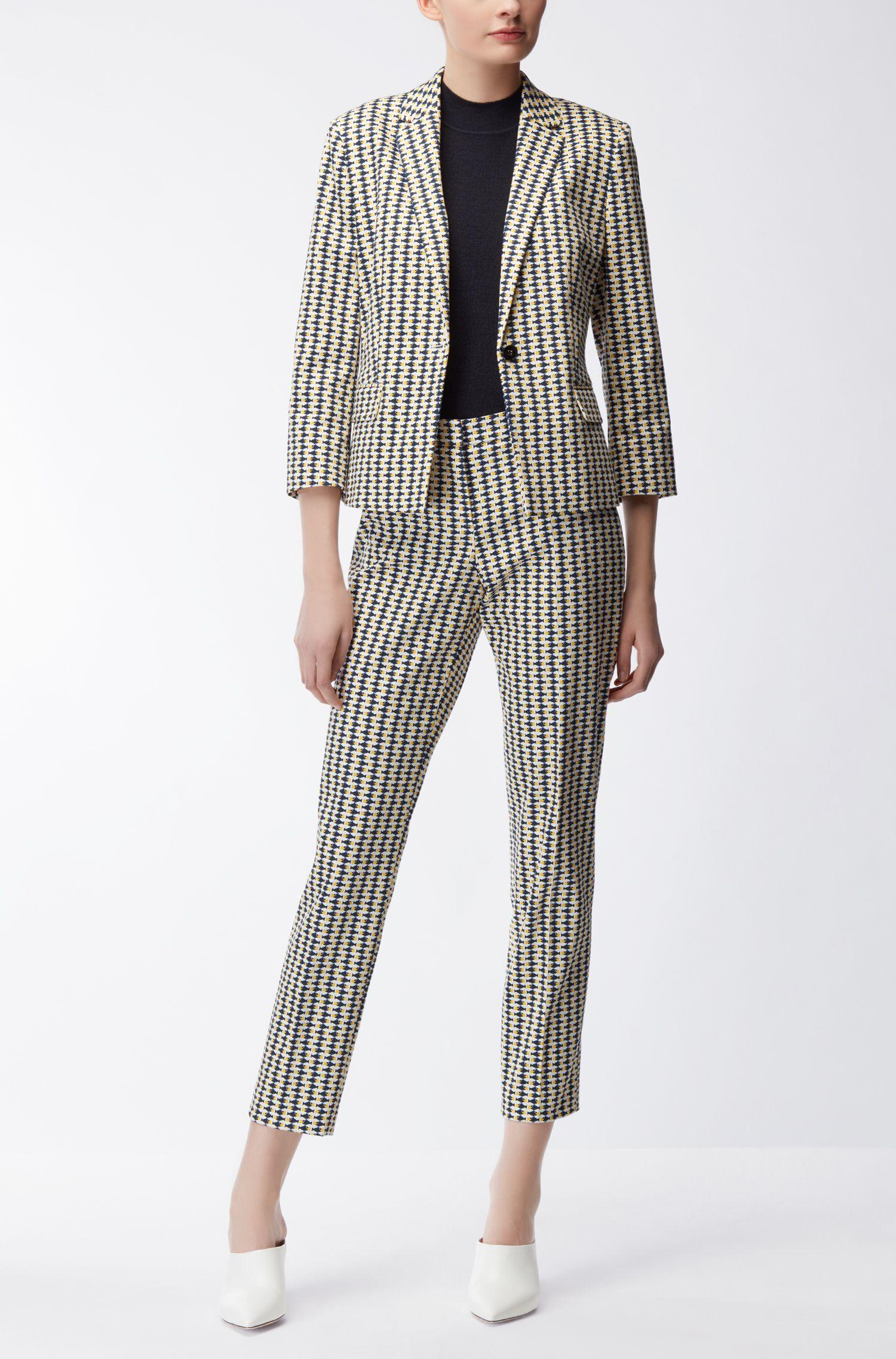 Jersey sin mangas en lana de merino con un moderno tejido de piqué