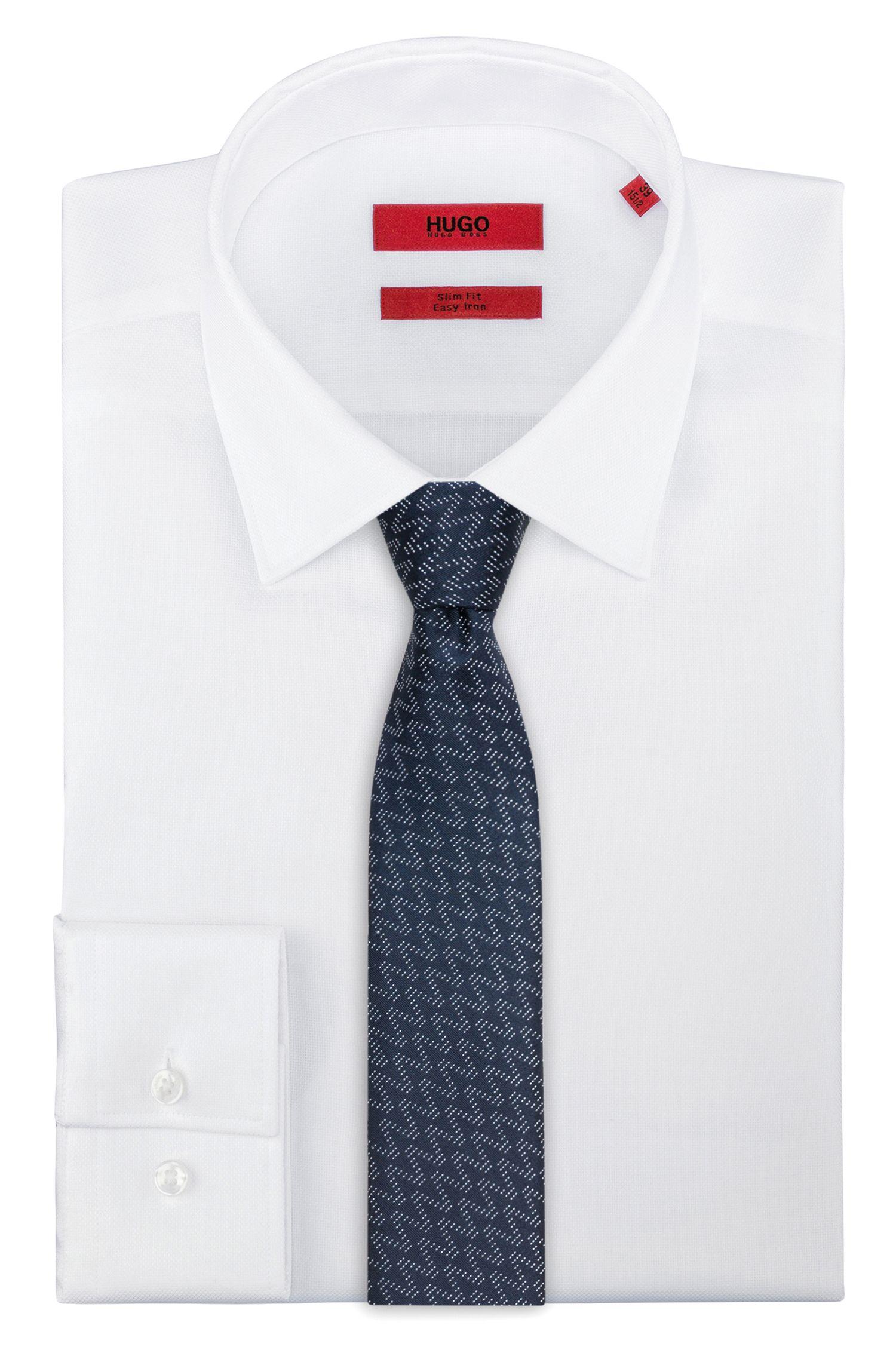 Cravate droite en jacquard de soie à motif en zigzag