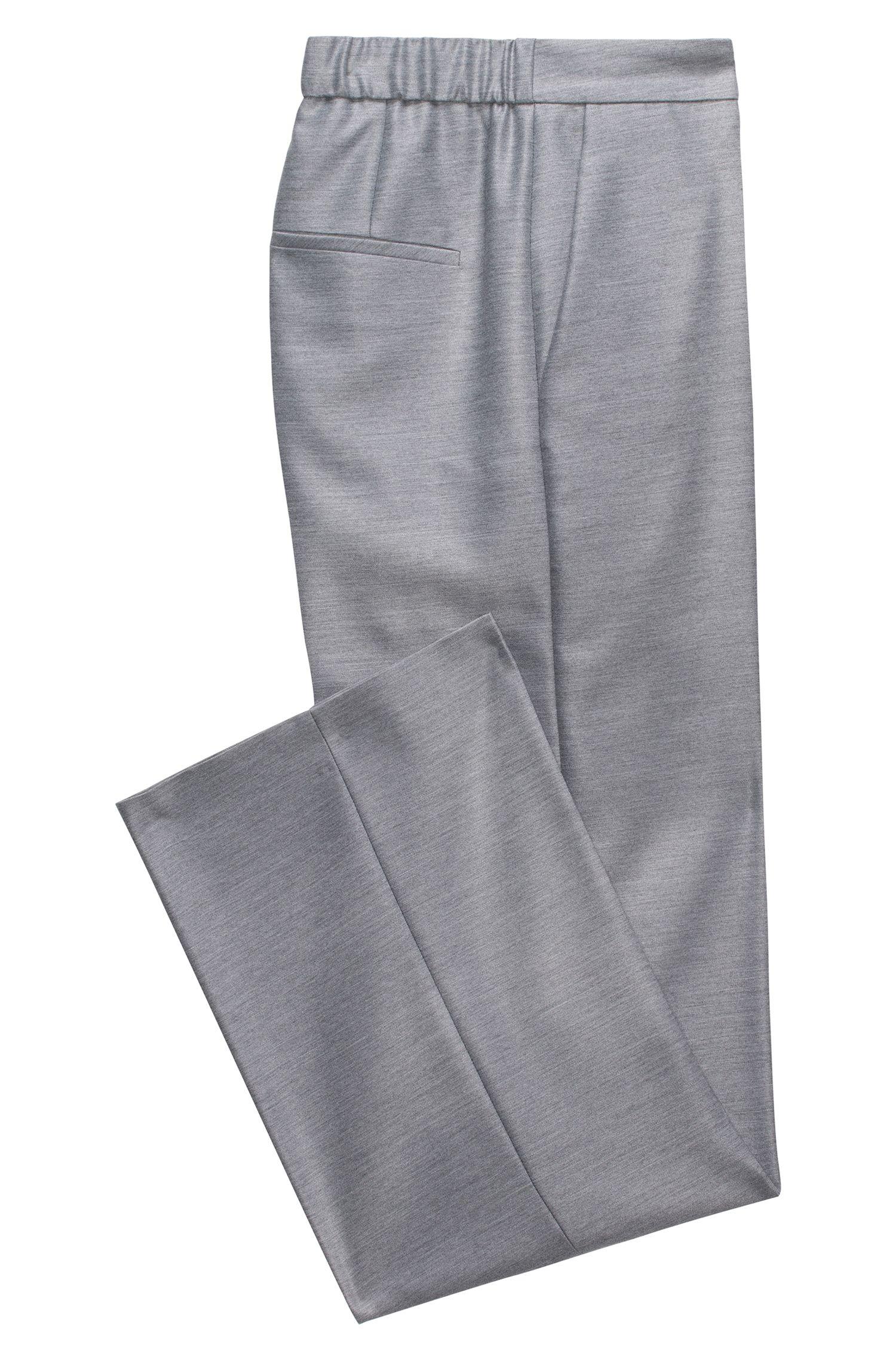 Pantaloni relaxed fit con gamba svasata