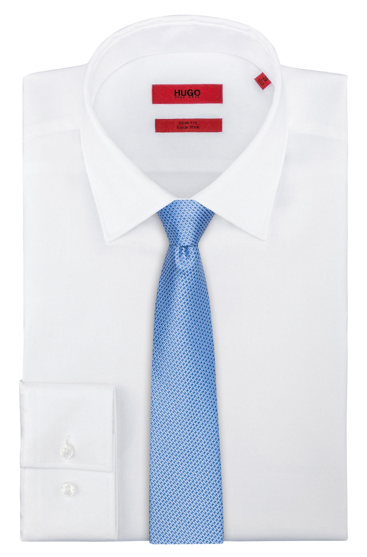 Moderna cravatta con microdisegni in jacquard di seta