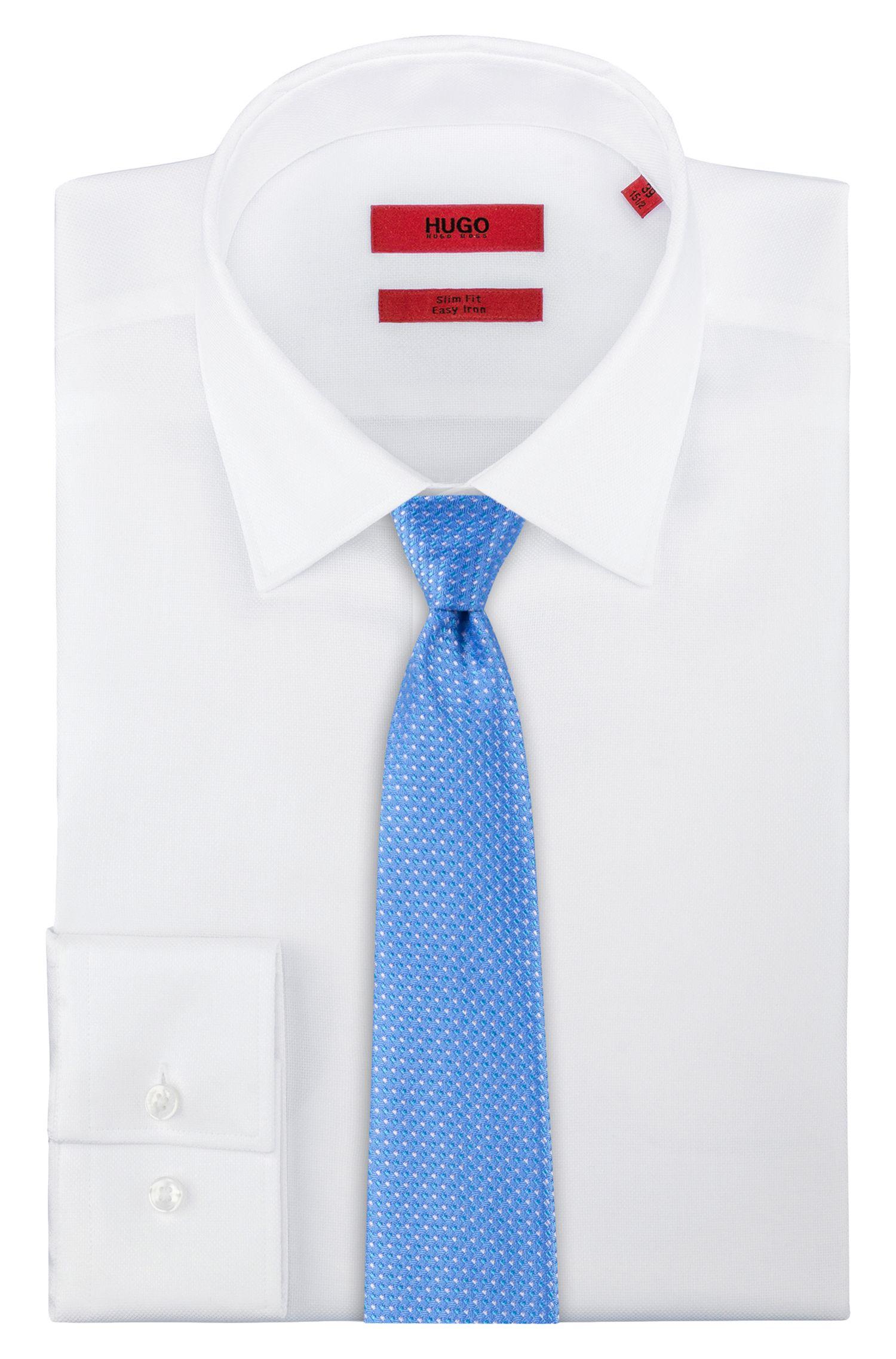 Cravate en jacquard de soie avec motif