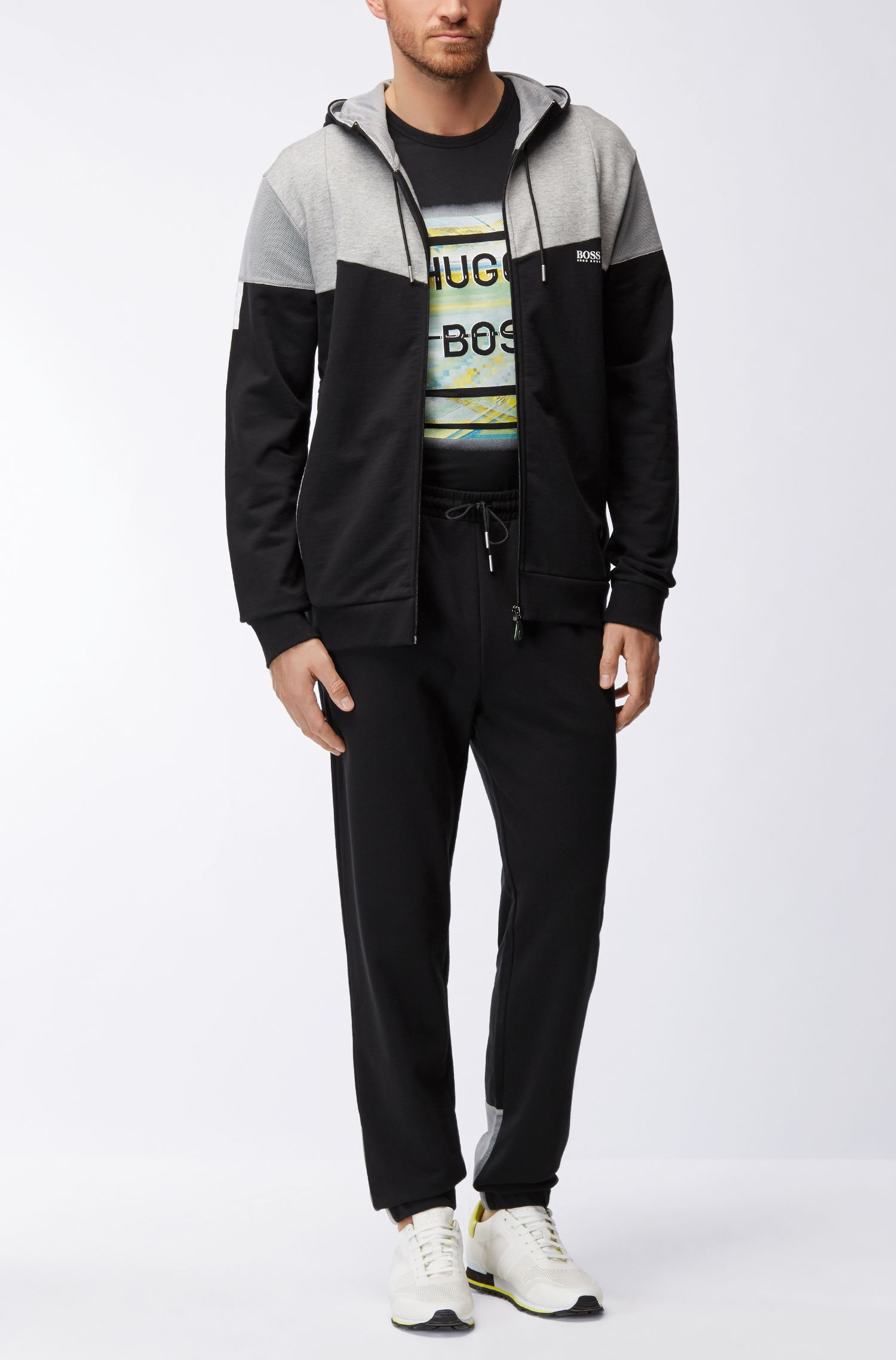 Pantaloni da jogging in cotone con pannelli in rete