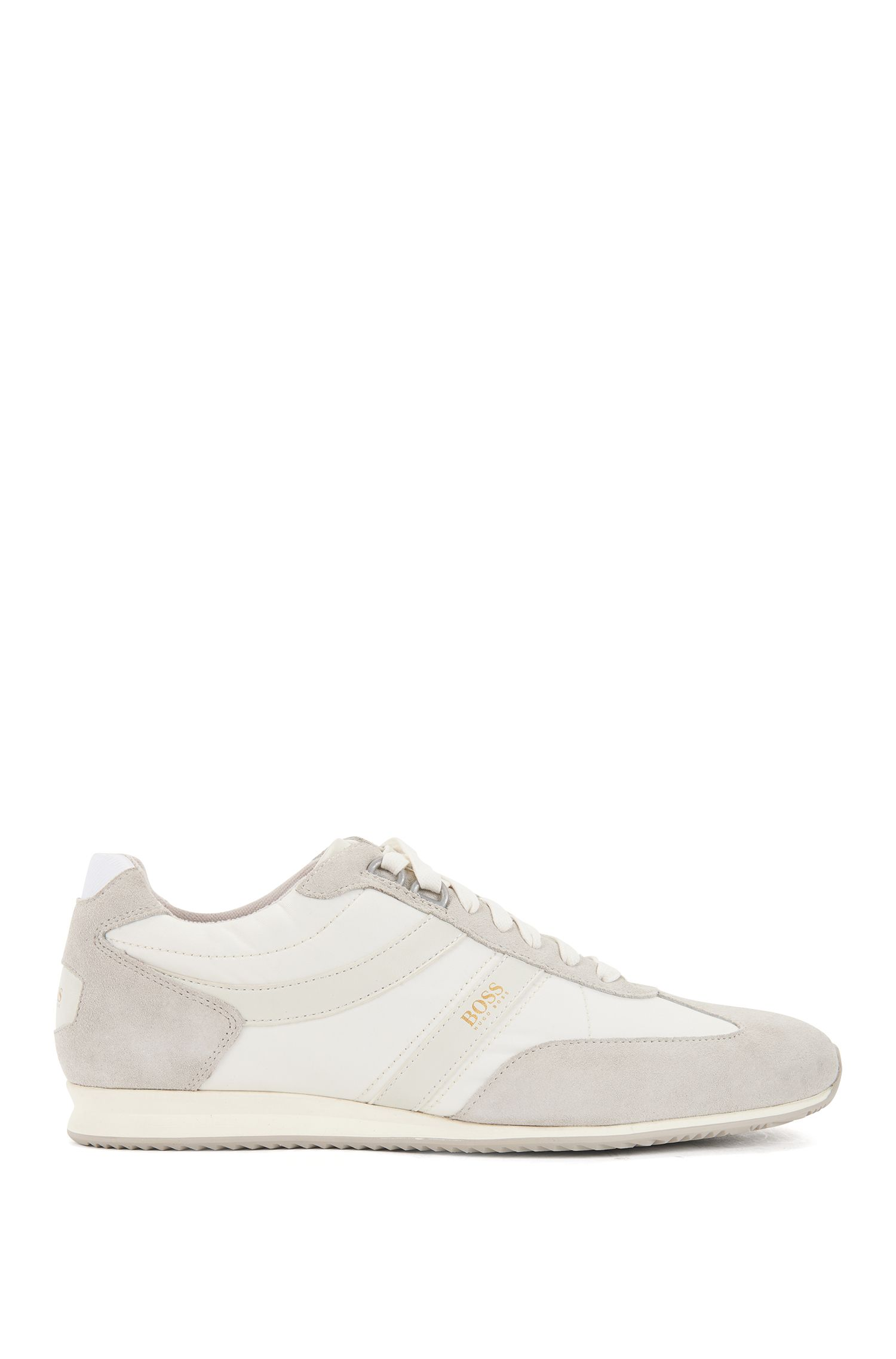 Lace-up trainers with suede overlays