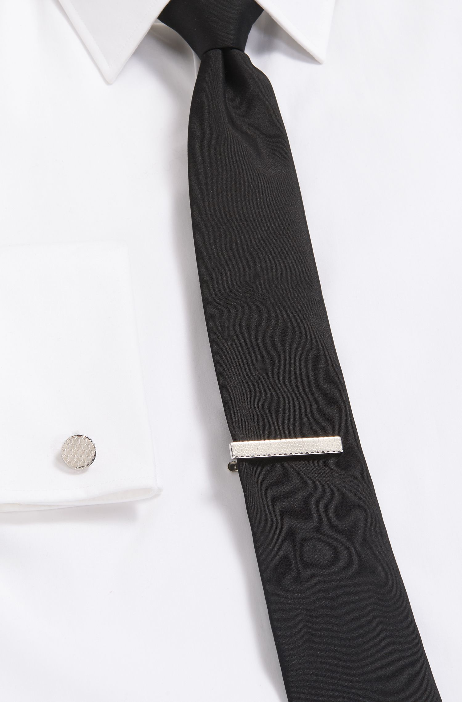 Hand-polished tie clip with engraved anchor design