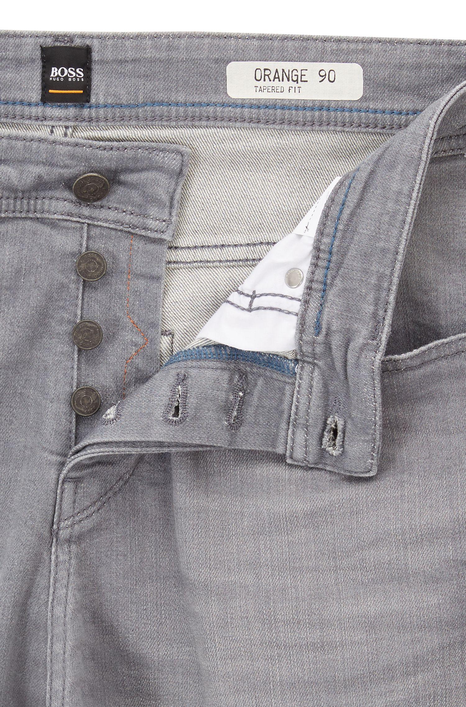 Tapered-Fit Jeans aus komfortablem Stretch-Denim mit Used-Effekten