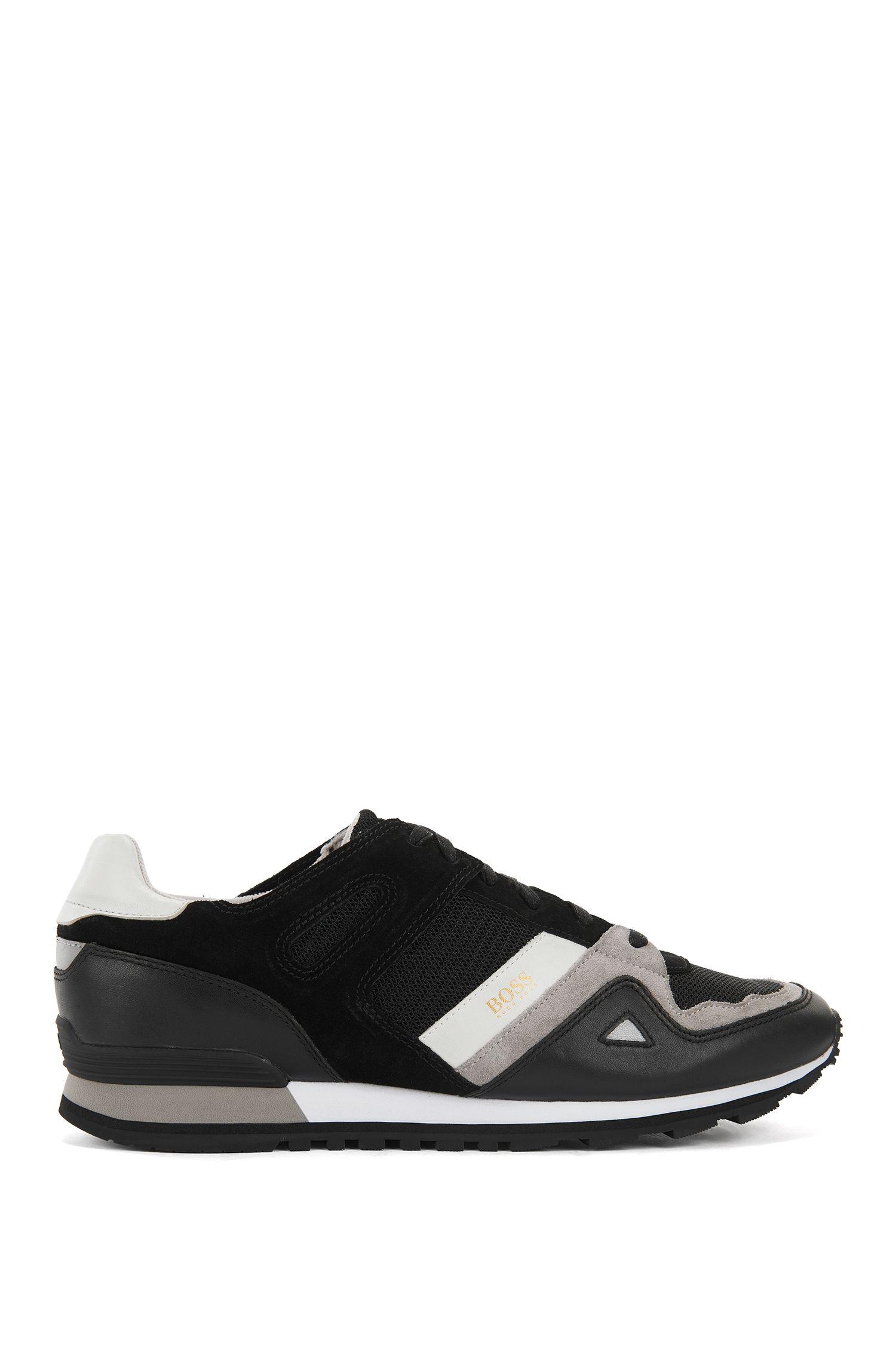 Chaussures de sport à lacets avec revêtement en cuir