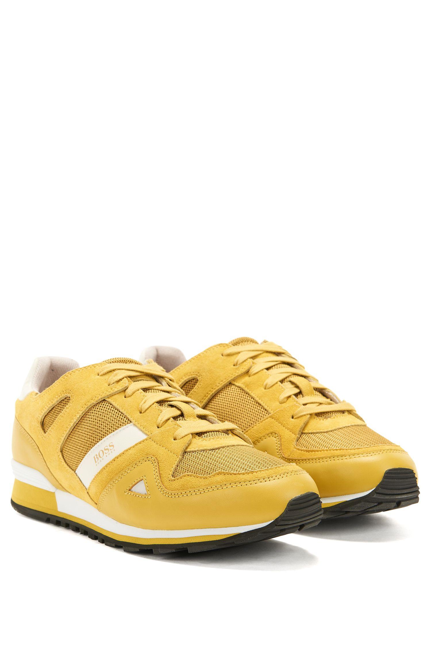 Sneakers stringate con rivestimenti in pelle