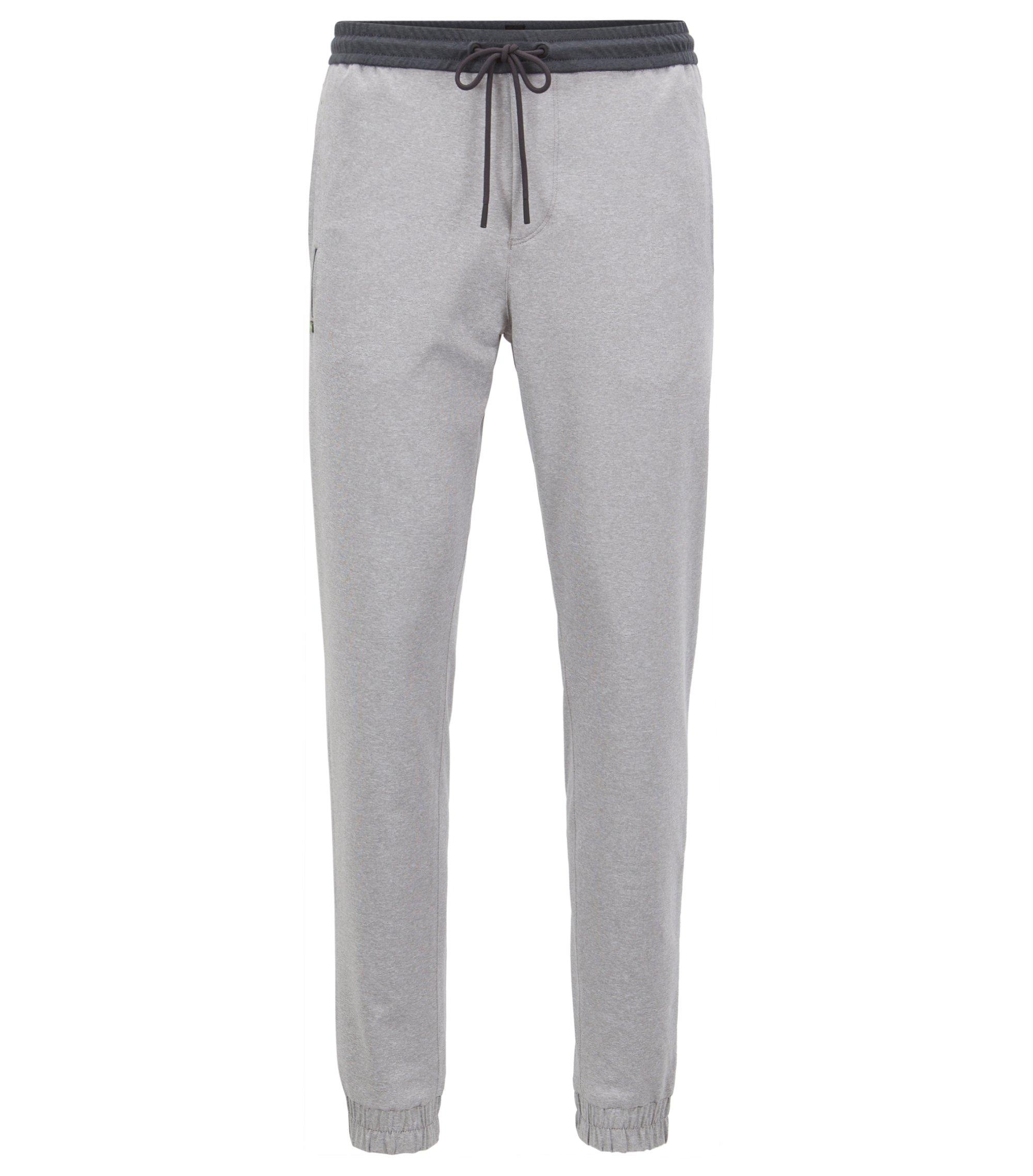 Pantaloni slim fit in mélange elasticizzato attivo con fondo gamba elastico, Grigio chiaro
