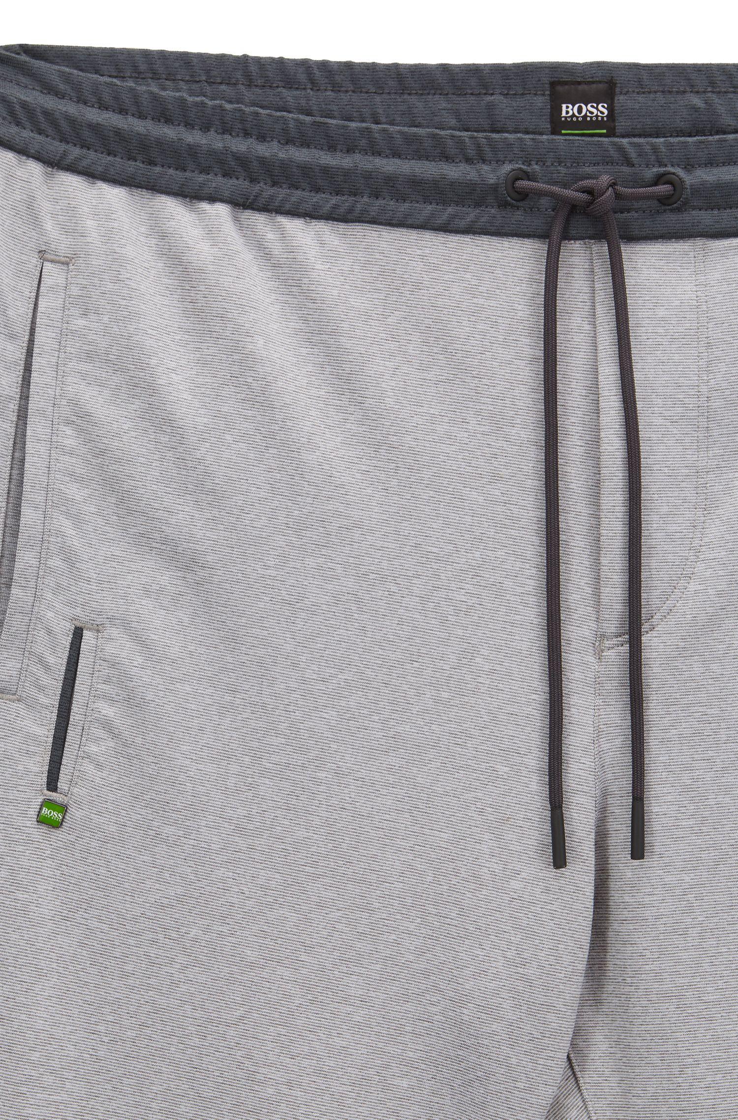 Slim-Fit Hose aus elastischem Material-Mix mit Bündchen