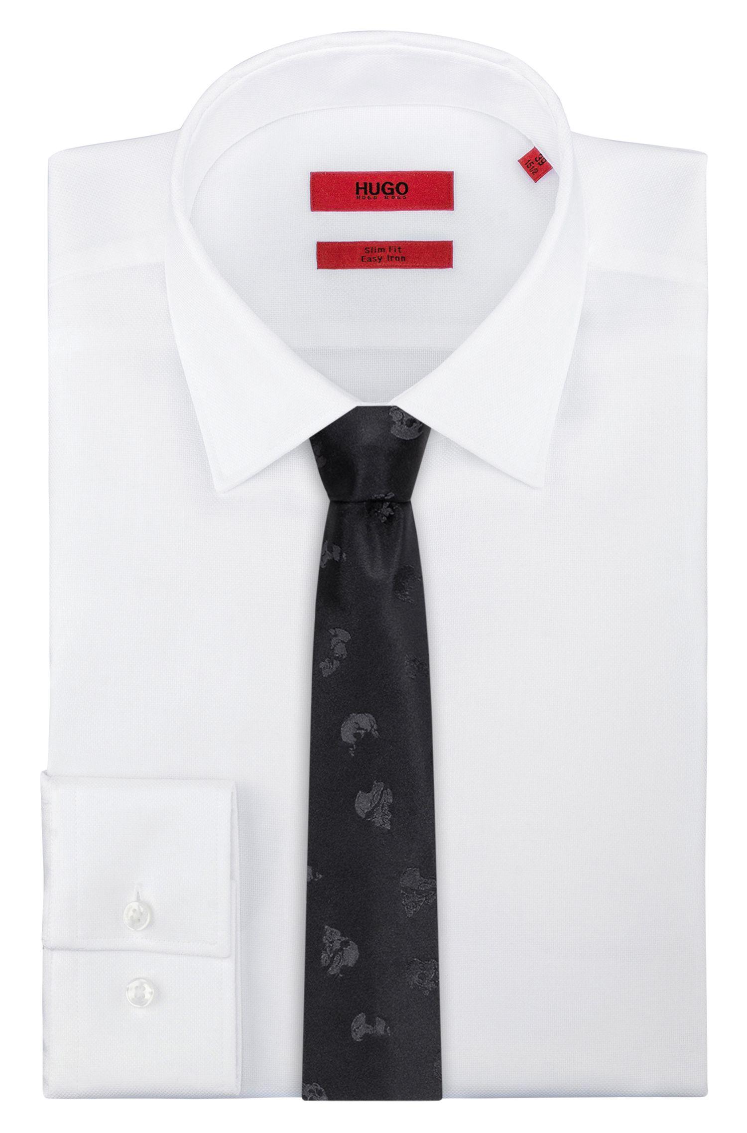 Cravate en soie à motif têtes de mort ton sur ton