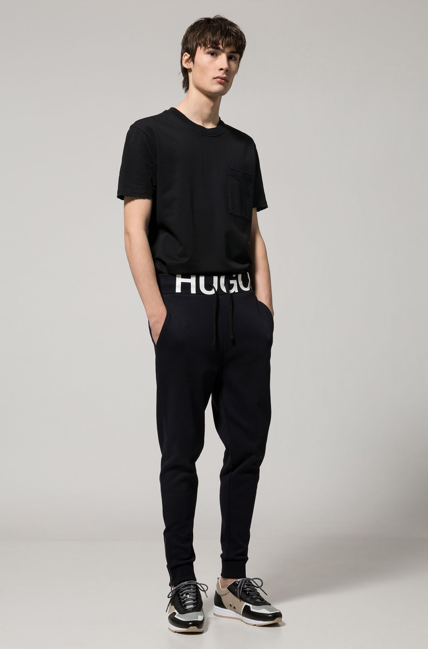 Regular-fit logo-waistband cotton-jersey trousers