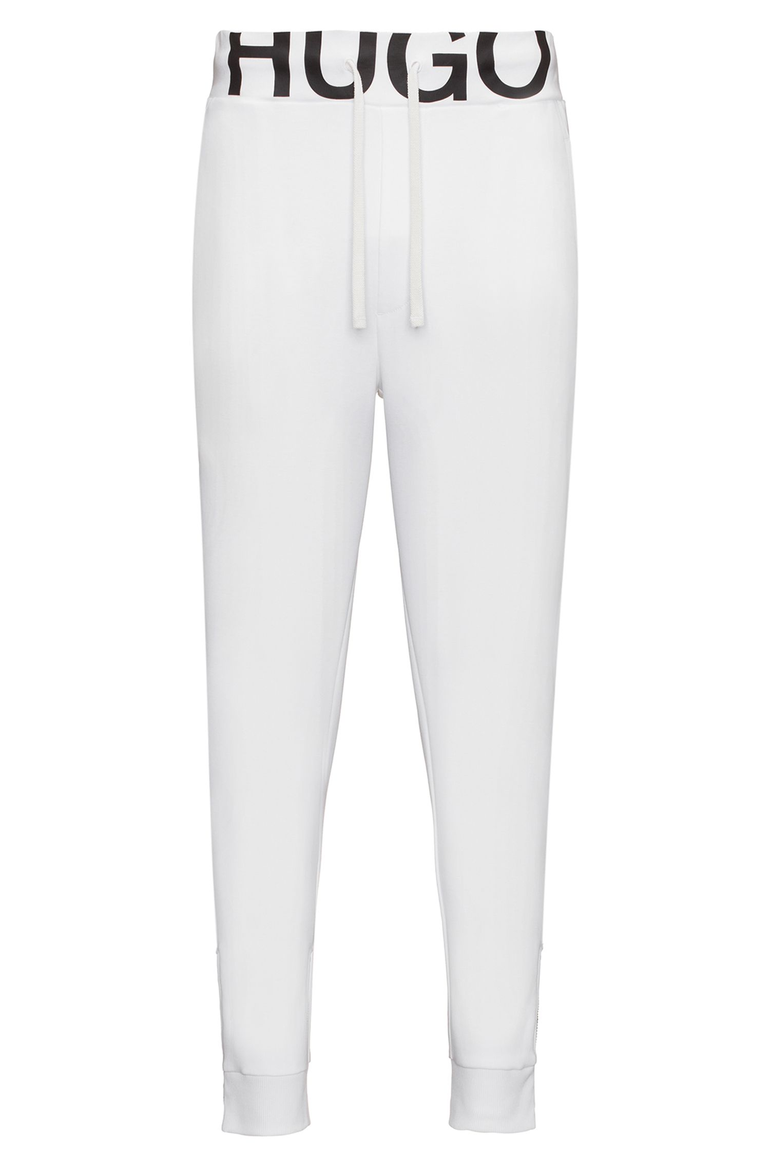 Pantalones regular fit de punto de algodón con logo en la cintura