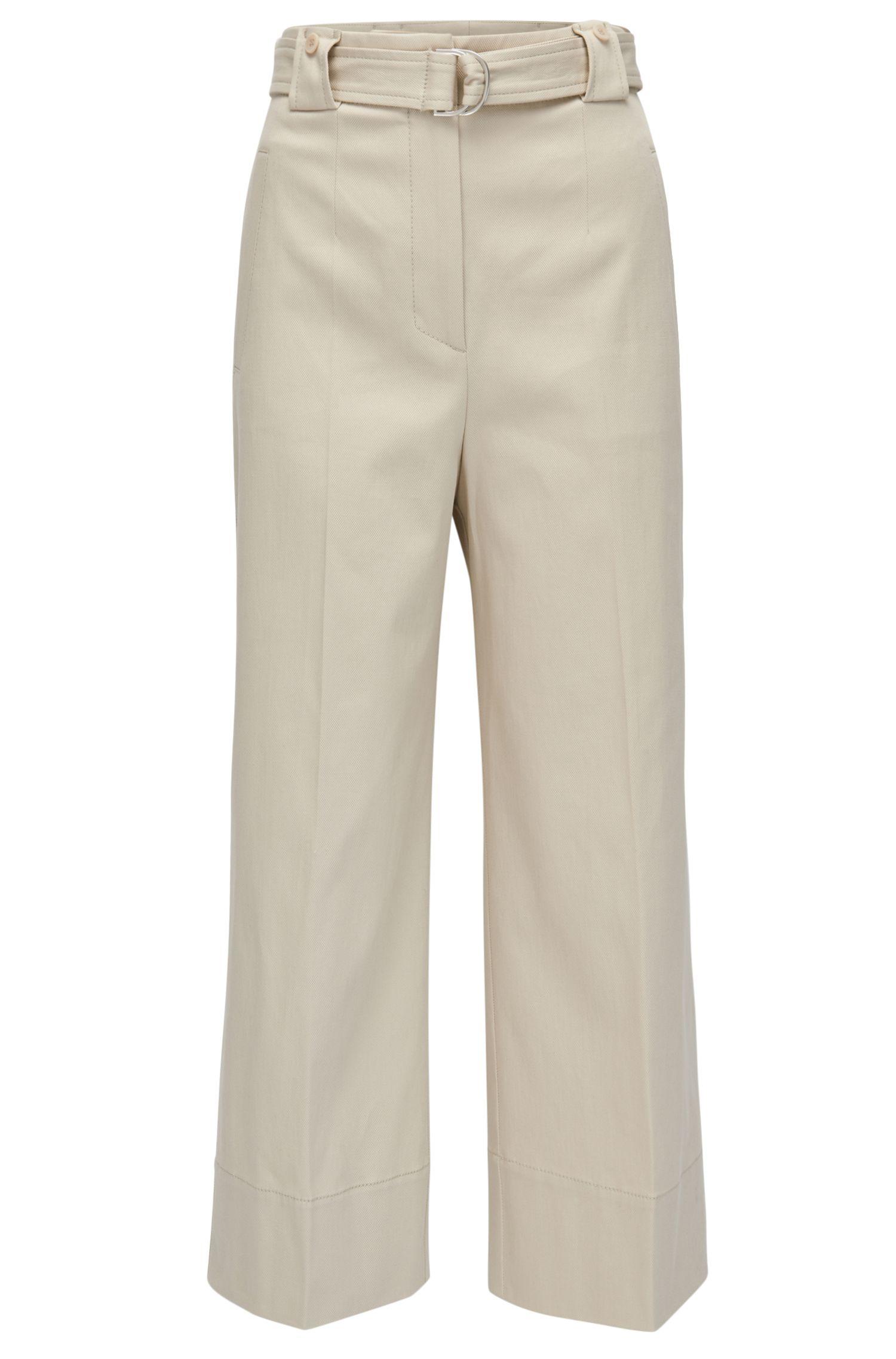 Pantalones regular fit en algodón elástico con pernera ancha