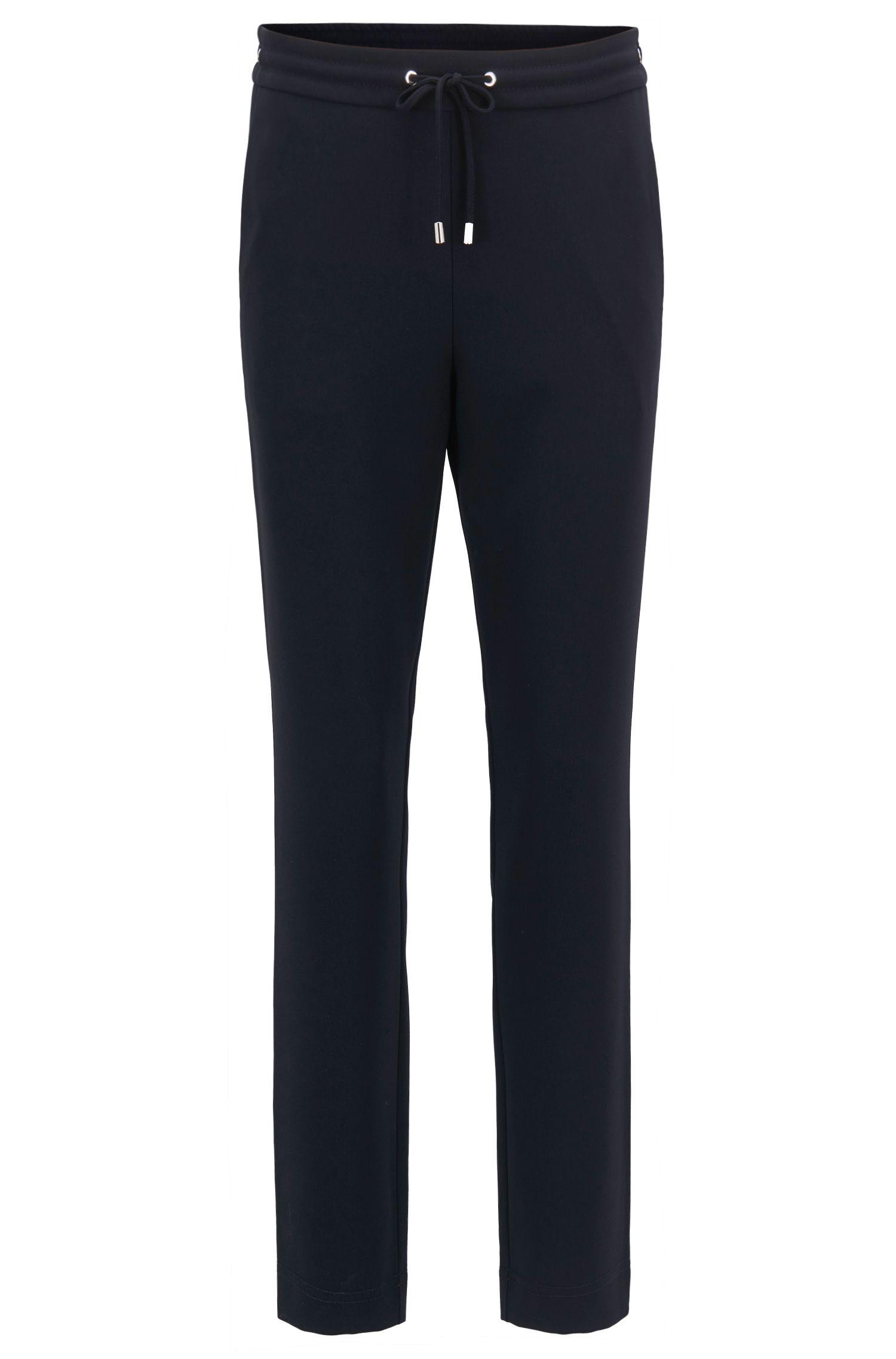Pantalon raccourci style athleisure en crêpe technique