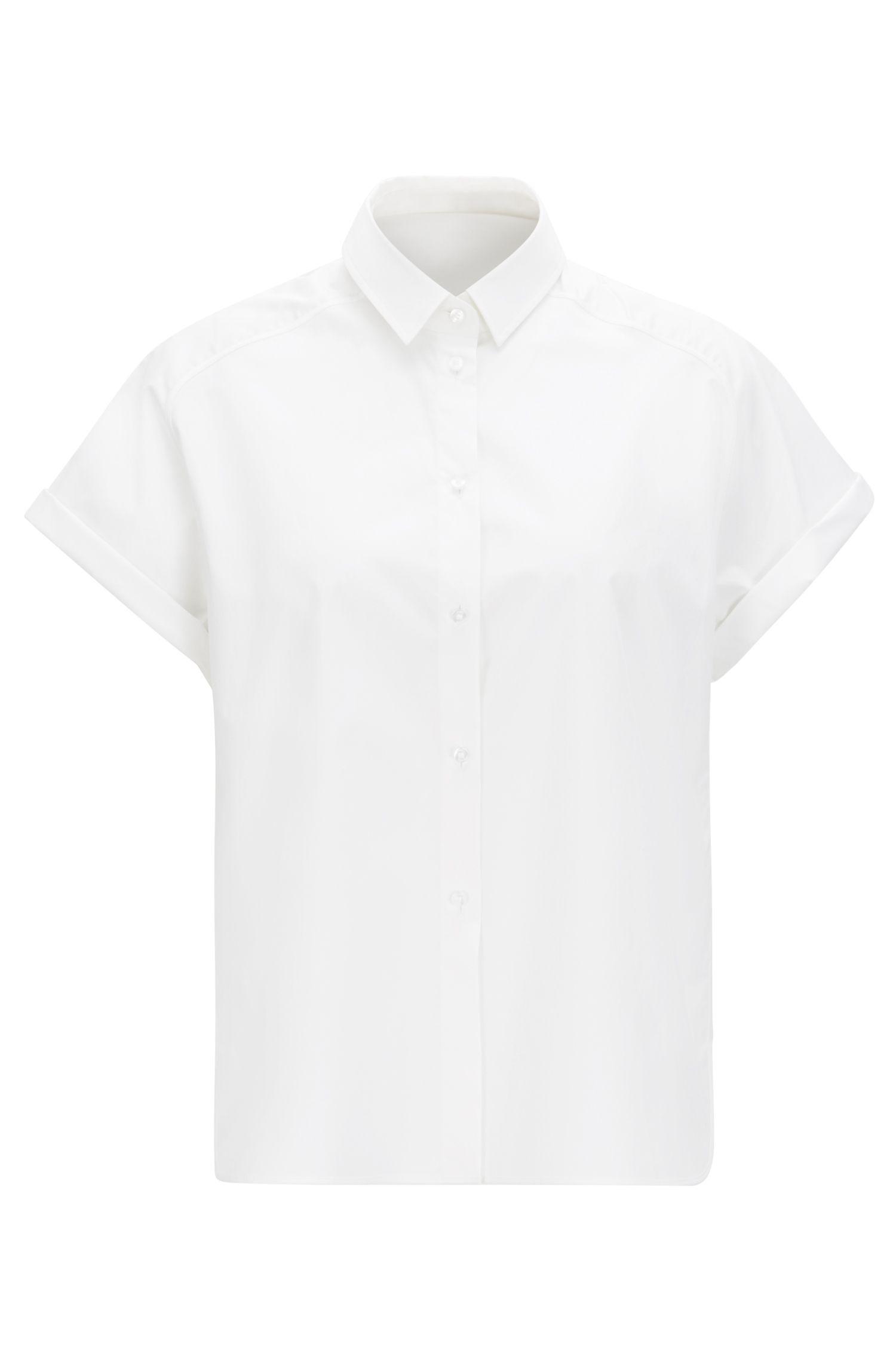 Blusa relaxed fit en algodón elástico suave
