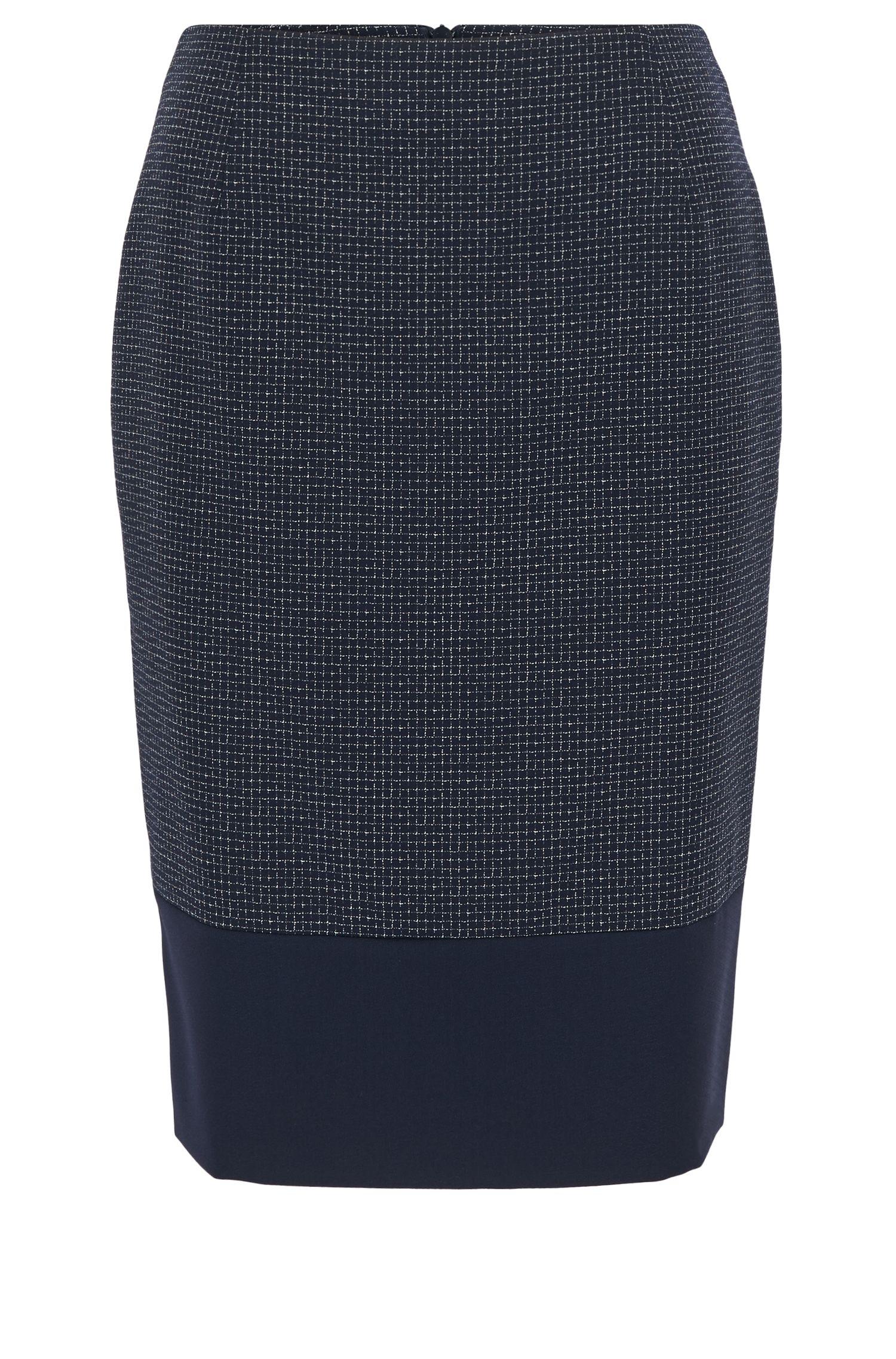 Jupe crayon en laine vierge à carreaux avec base accentuée