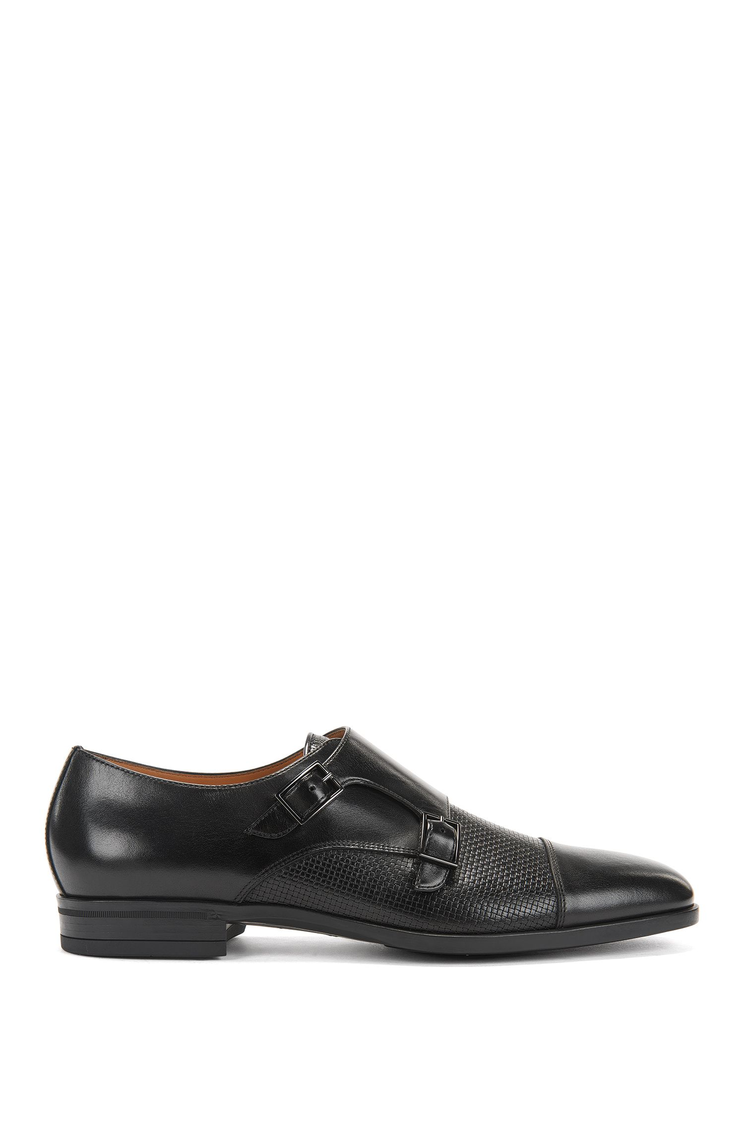 Double-monk shoes in plain and embossed leather