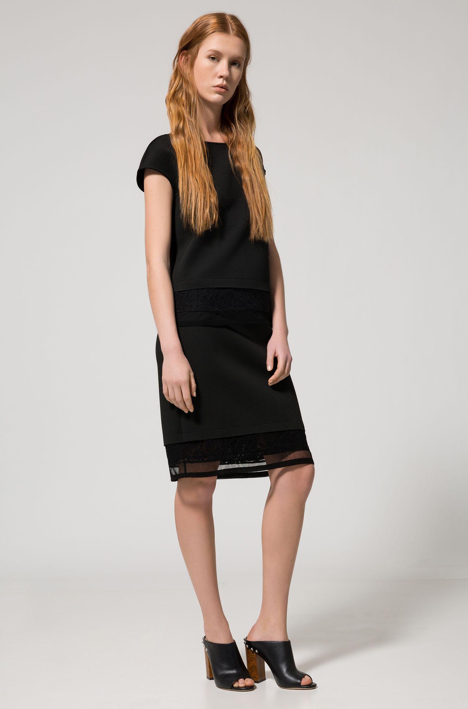 Falda midi en punto aglomerado con dobladillo de encaje y malla
