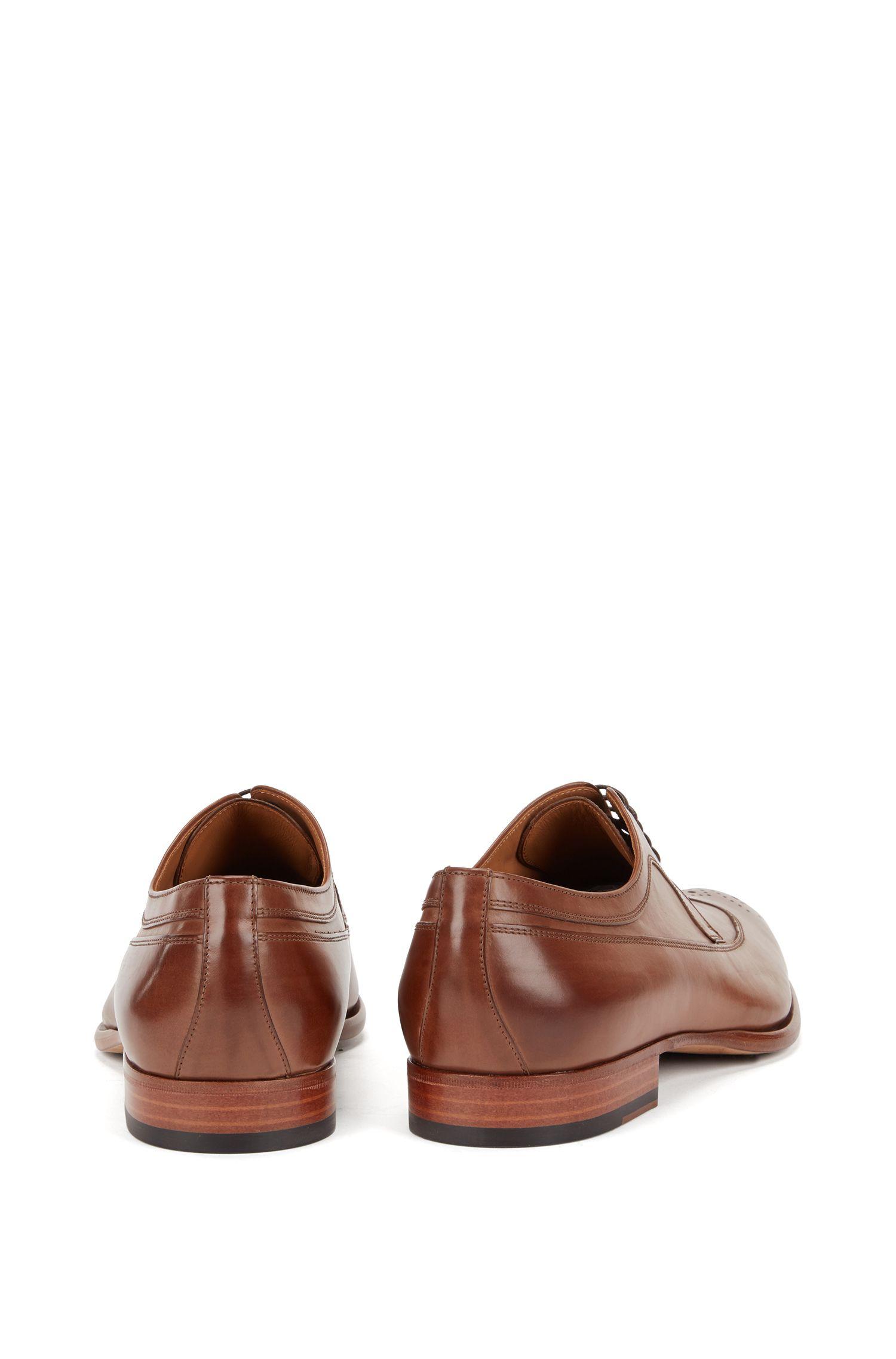 Chaussures derby en cuir à bout perforé
