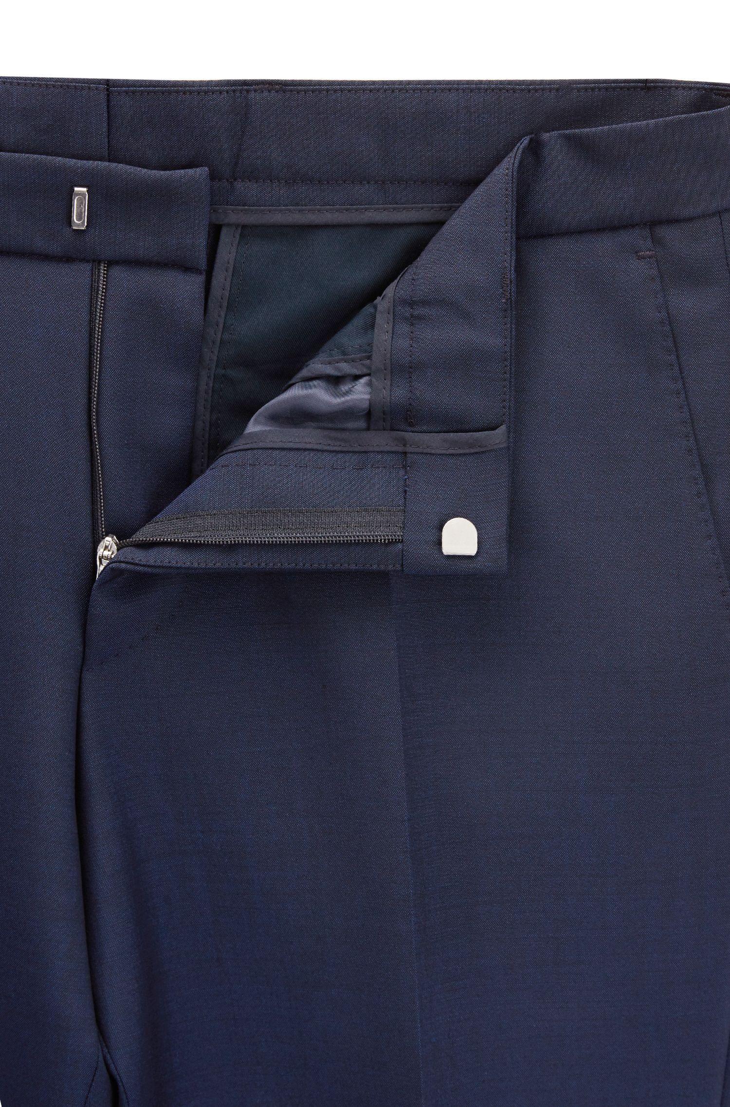 Slim-fit kostuum van een wolmix, met twee rijen knopen
