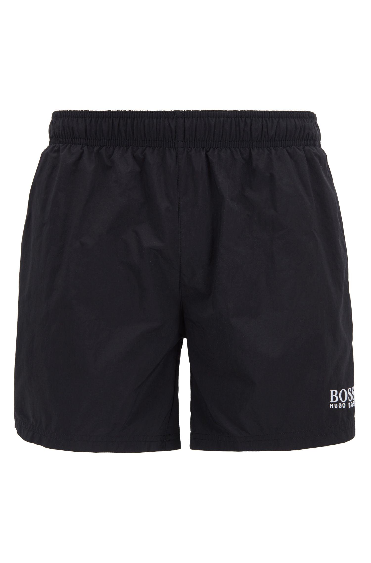 Bañador tipo shorts de secado rápido con logo bordado