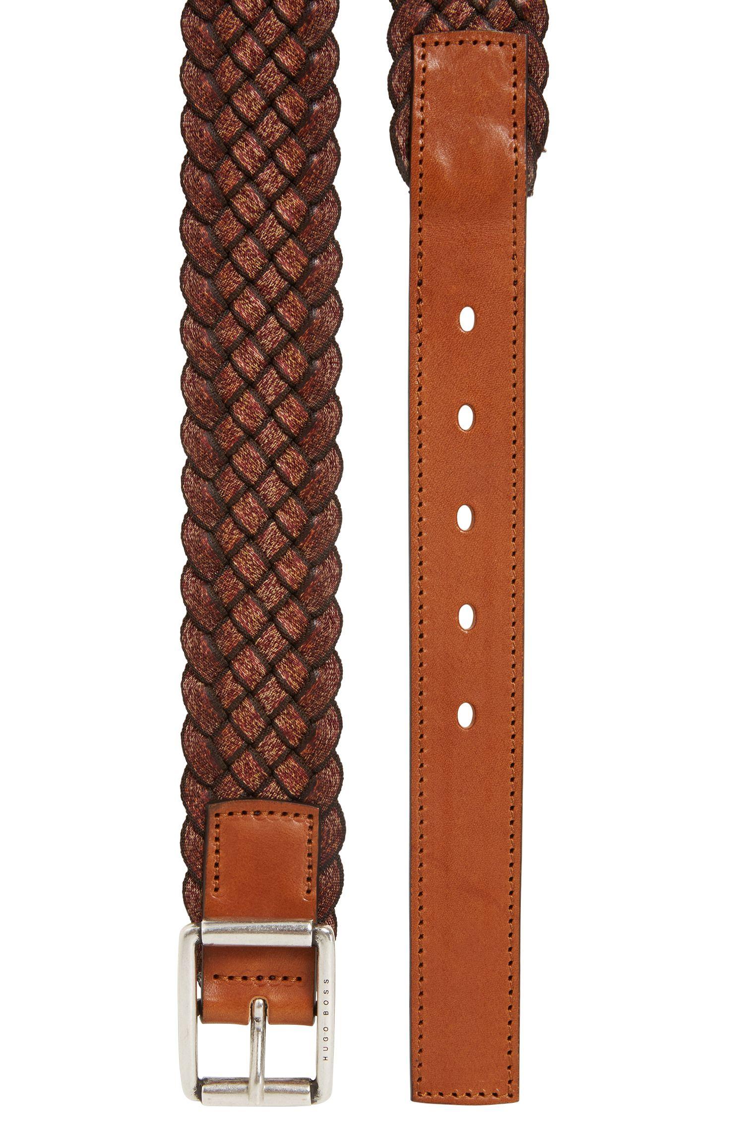 Cinturón de tejido en varios tonos con aplique de piel