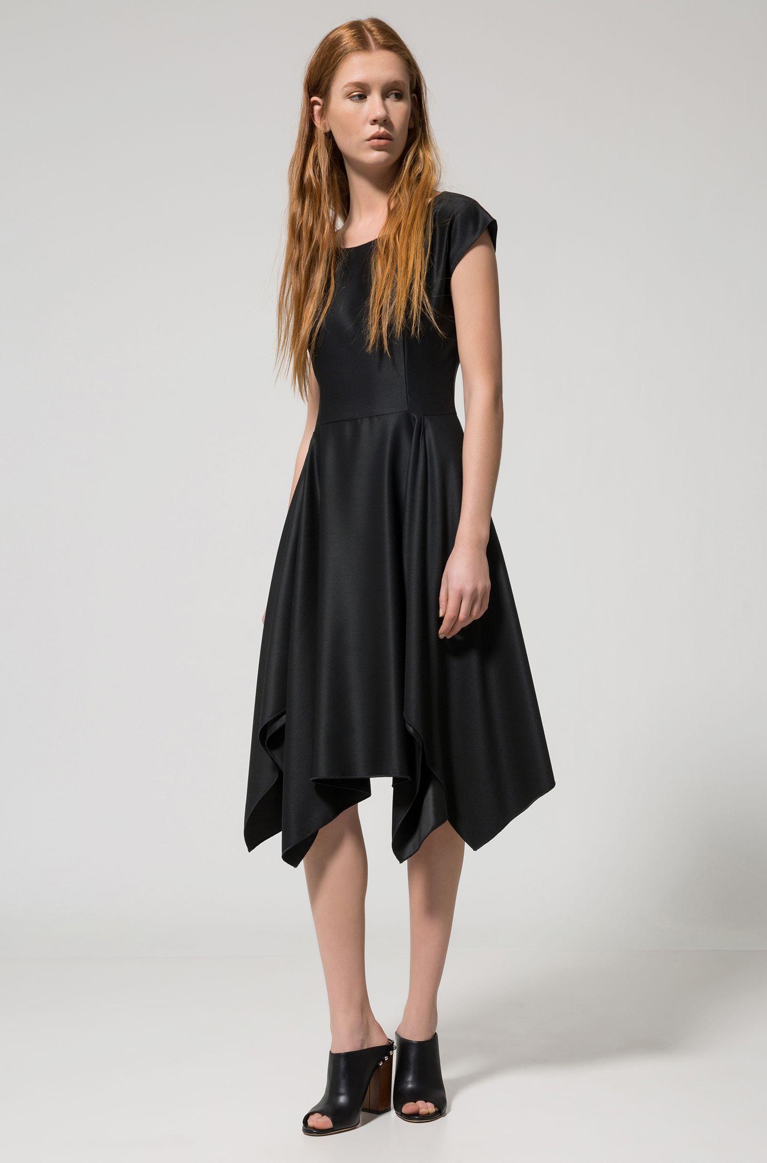 Modern short-sleeved dress with voluminous skirt and uneven hem