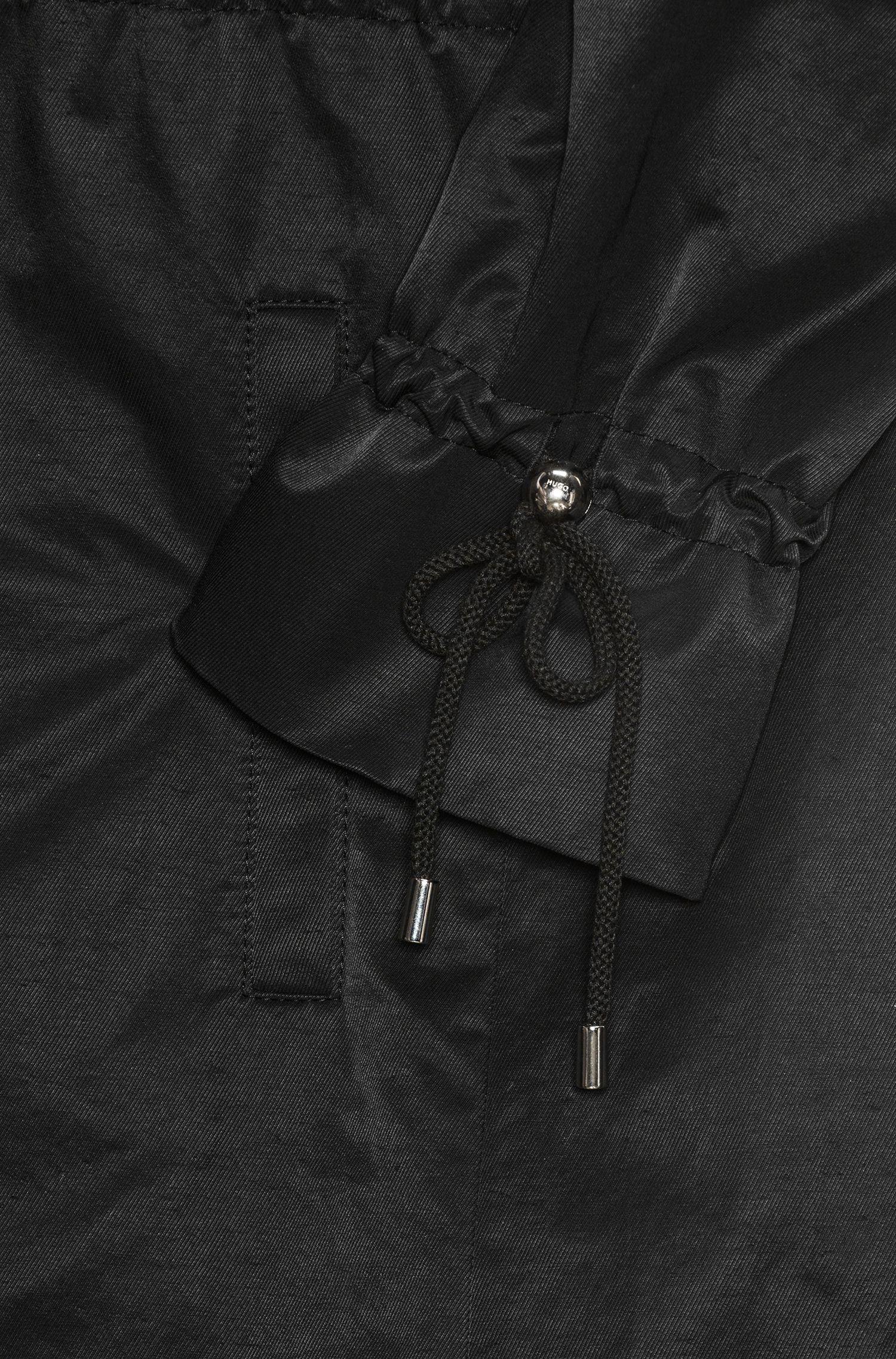 Waterafstotende trenchcoat van een katoenmix met mouwen met trekkoord
