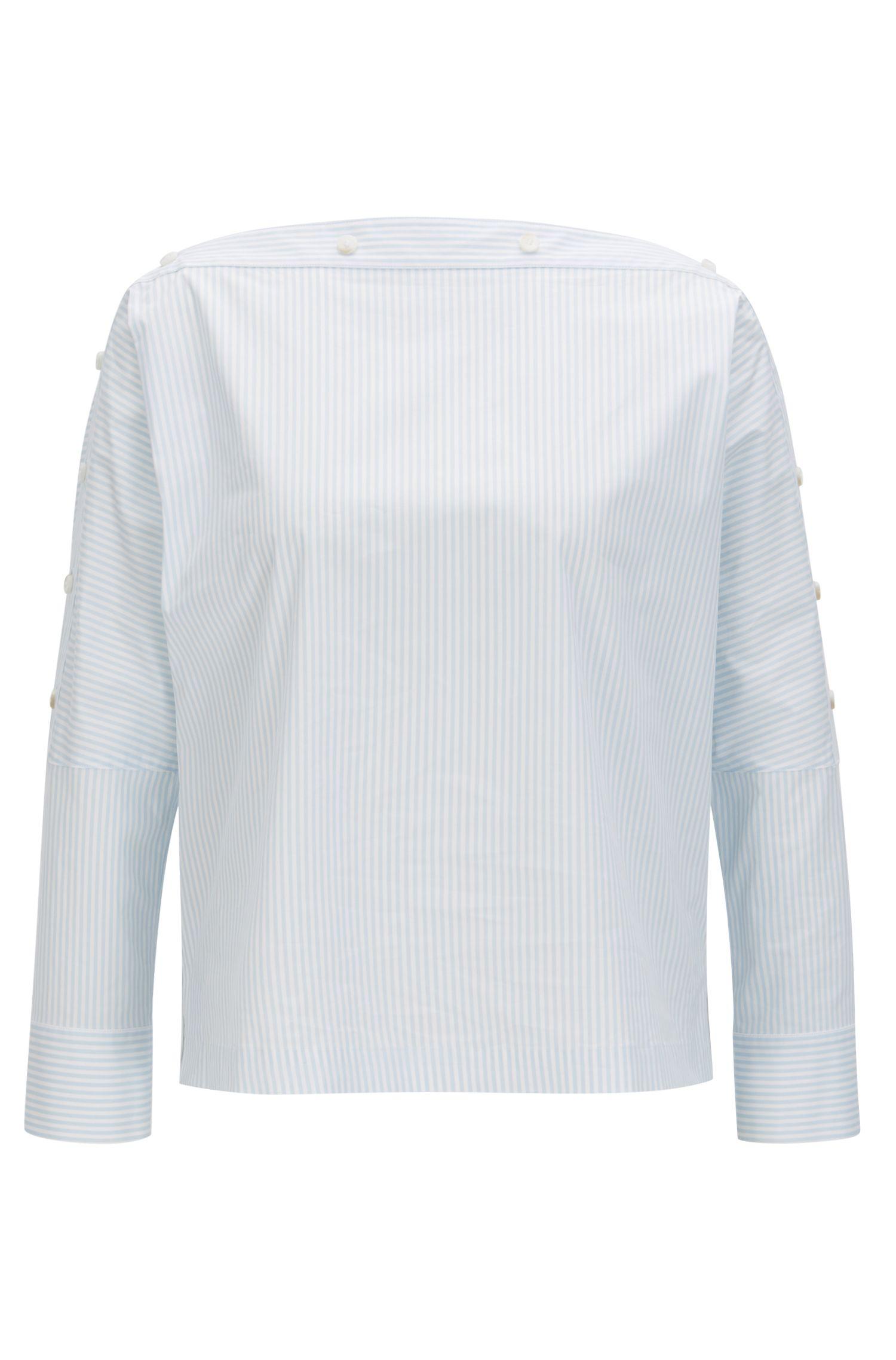 Blusa con cuello de botones en algodón elástico a rayas