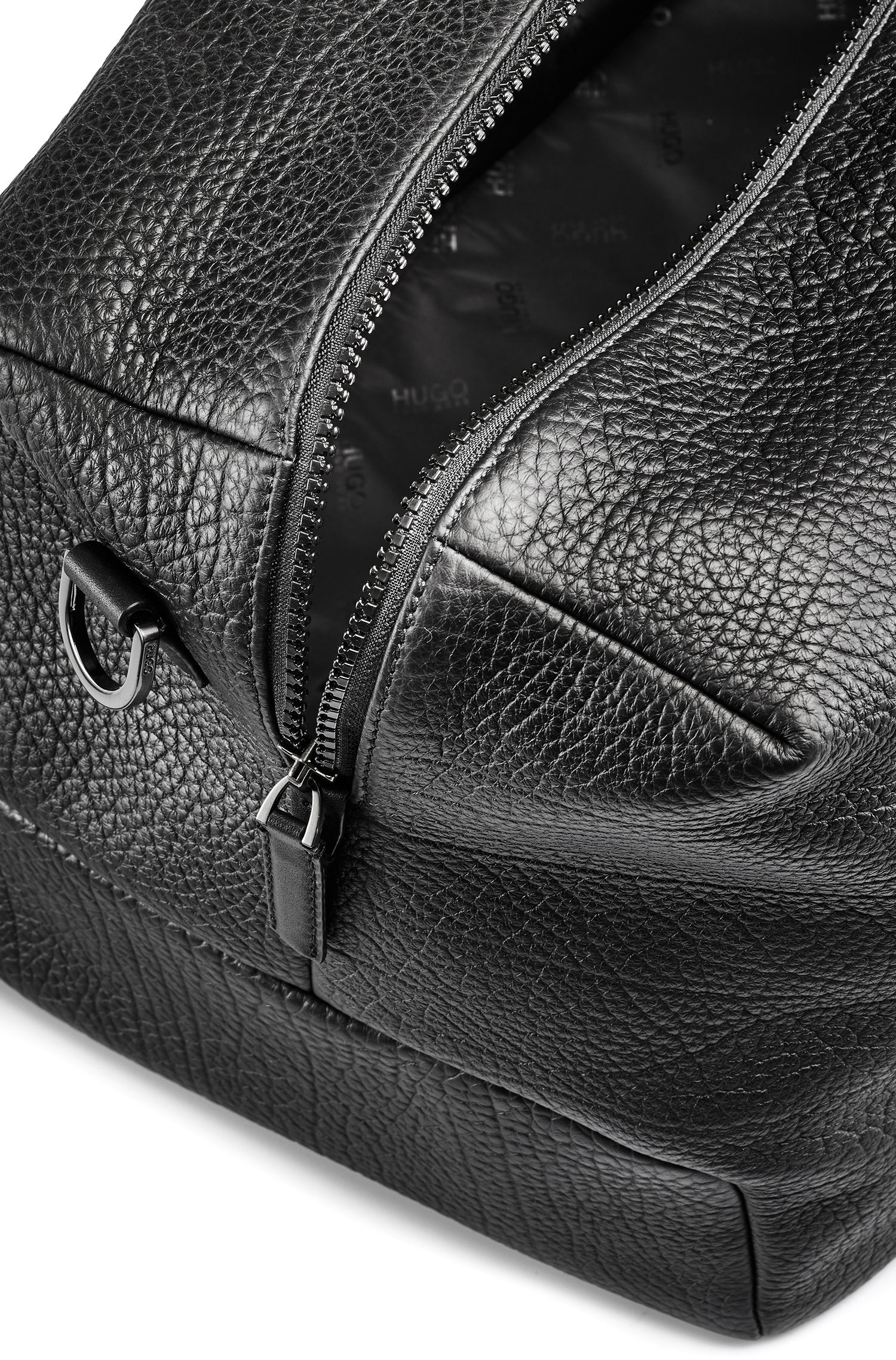 Holdall in buffalo-embossed leather with zipped pocket