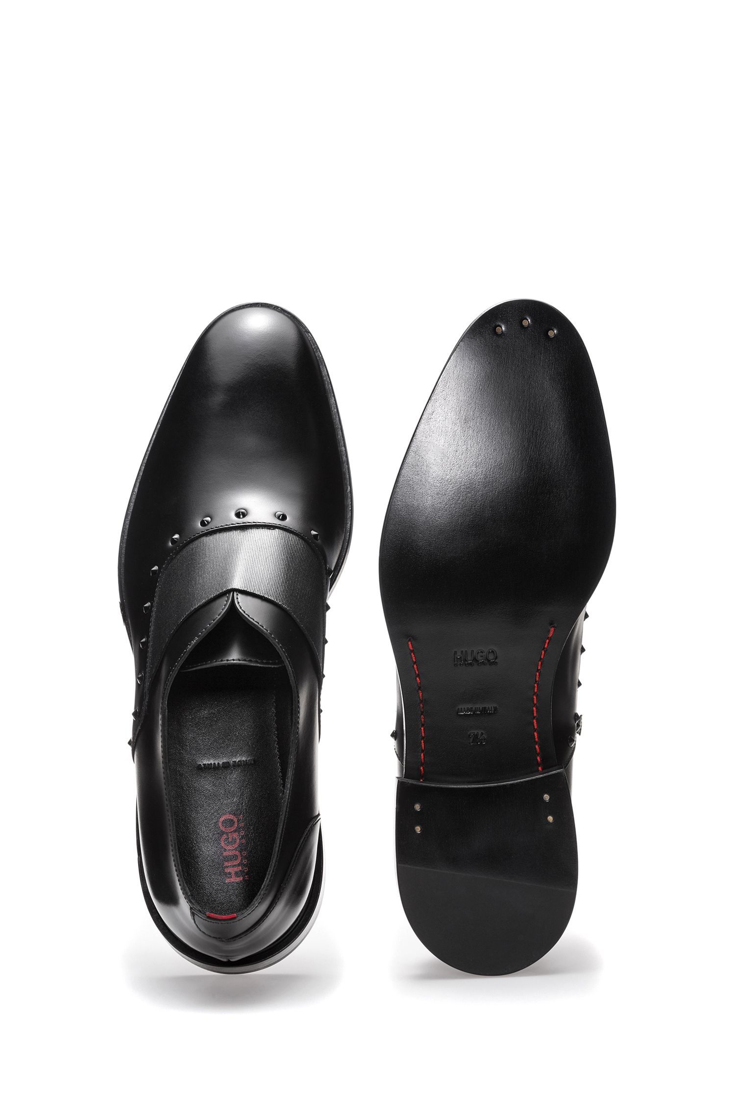 Slip-on leather dress shoes with stud detailing