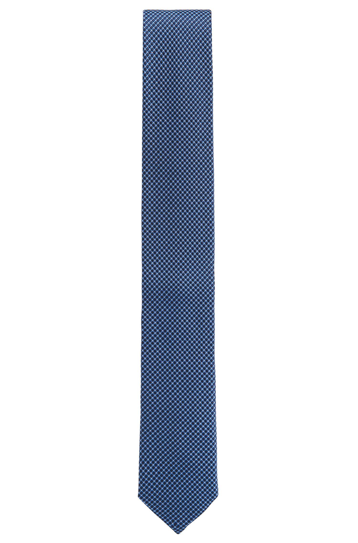 Cravate en jacquard de soie confectionnée en Italie, à micromotif