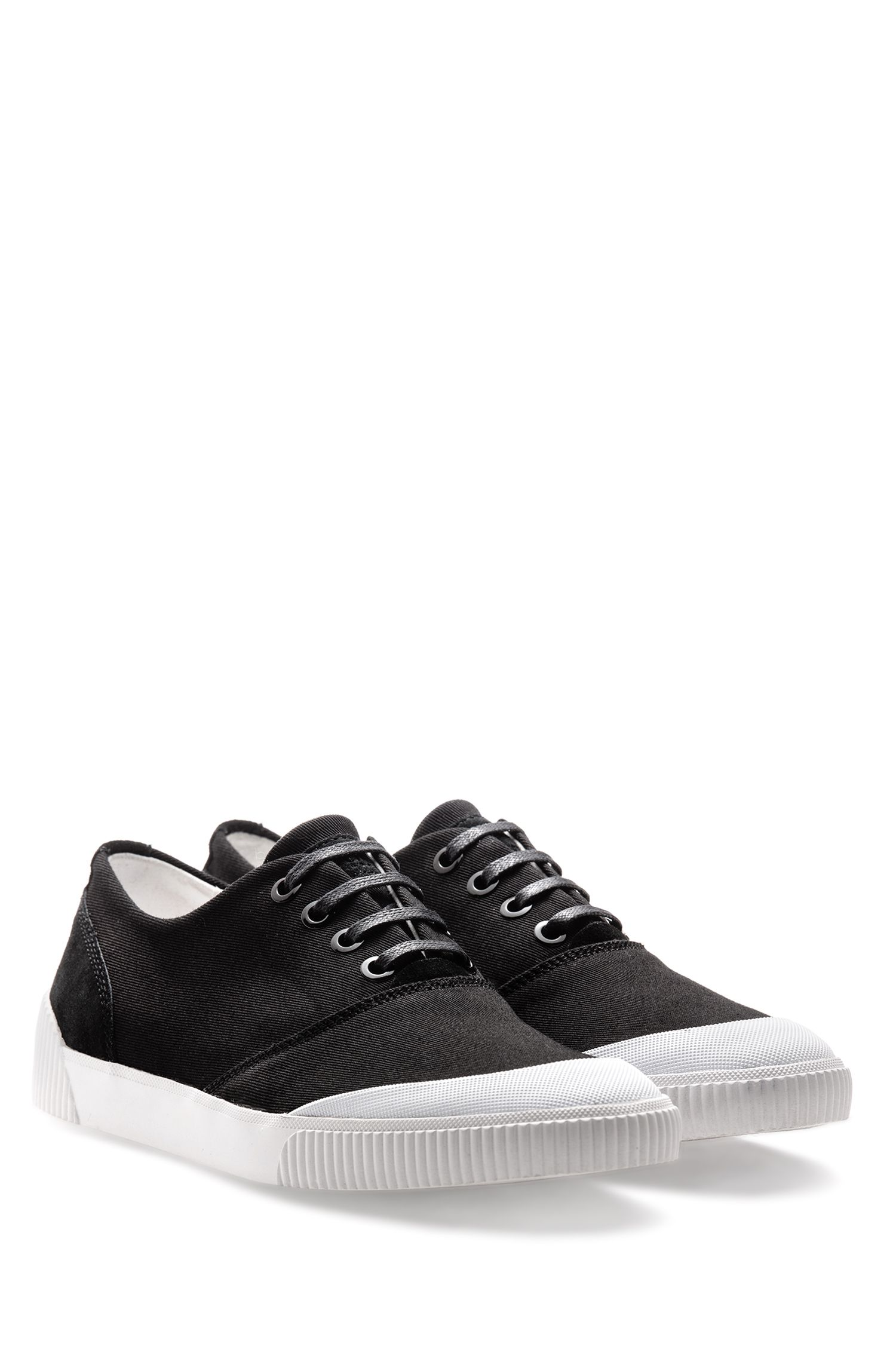 Low-top trainers in Italian leather and canvas