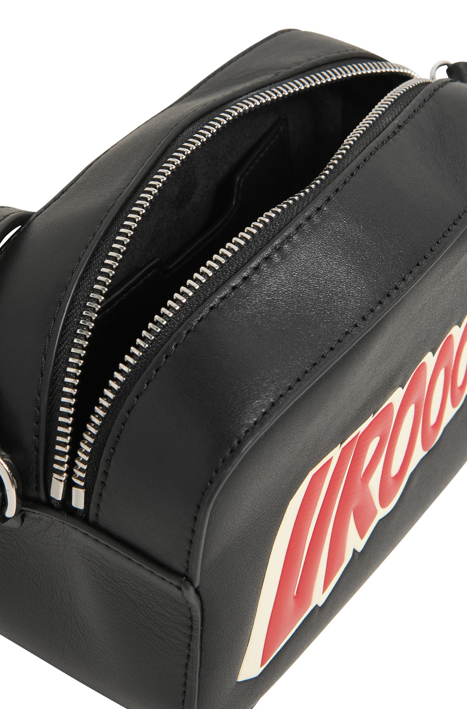 Leather crossbody bag with statement slogan