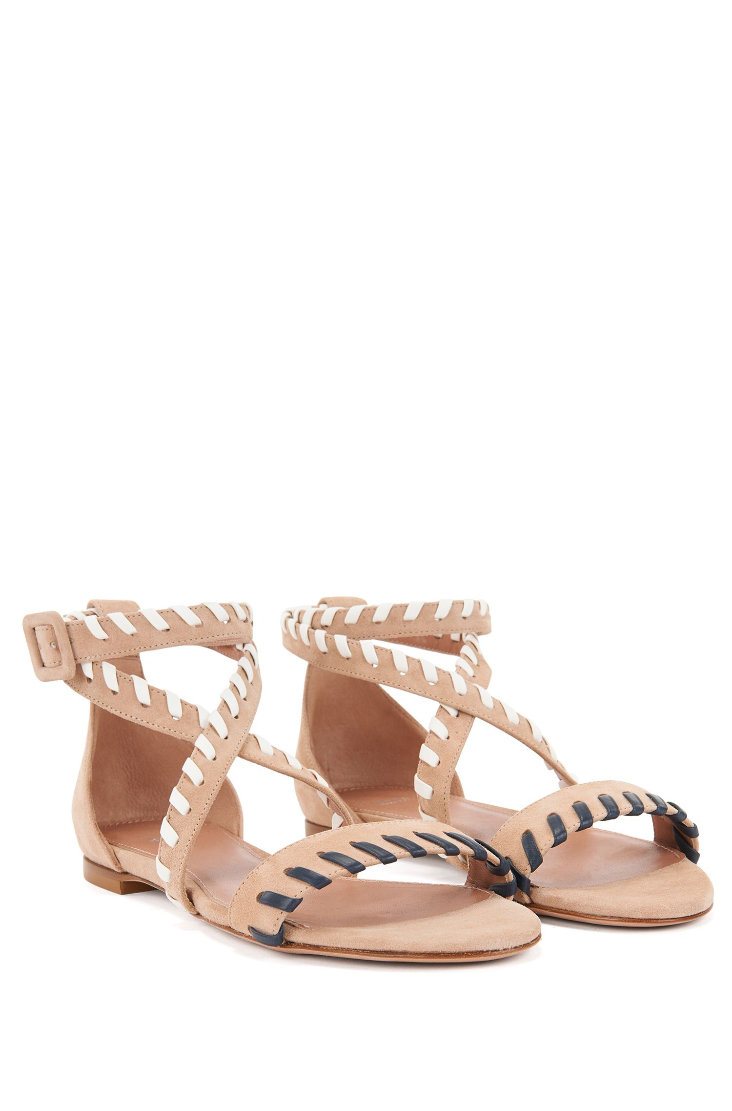 Flat suede sandals with whipstitching