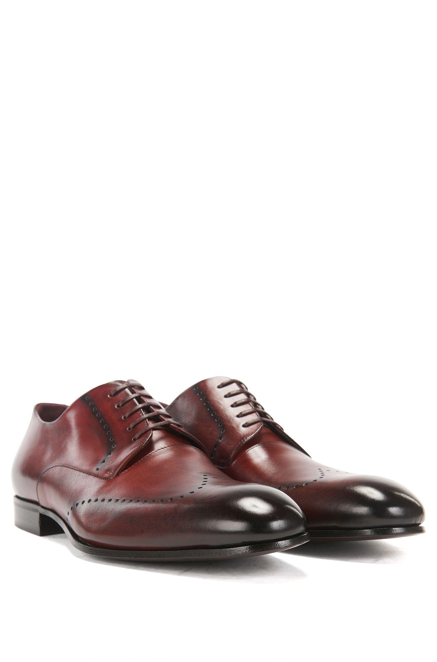 Zapatos Derby de piel pulida con detalles calados