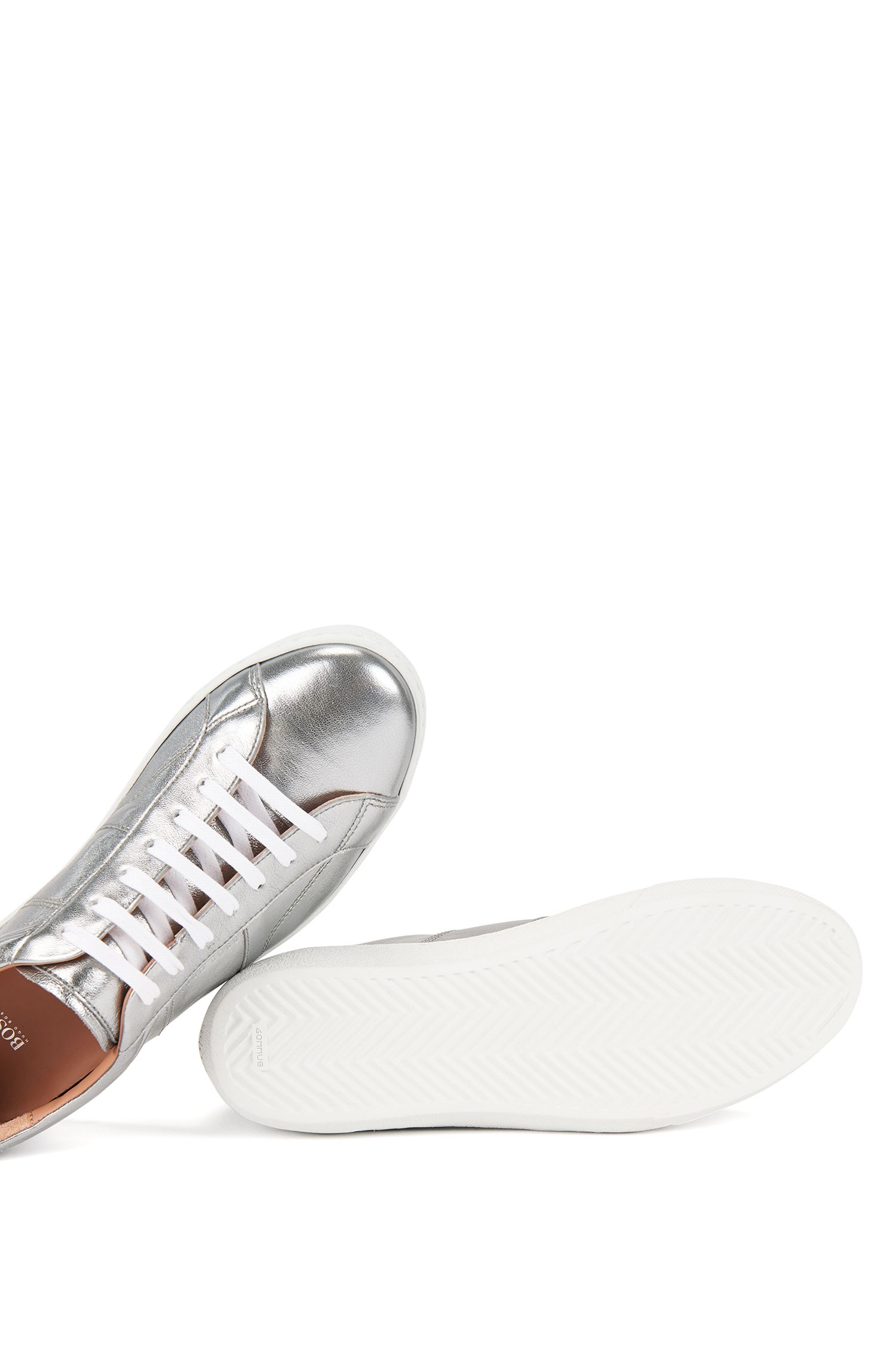 Low-top trainers in laminated leather