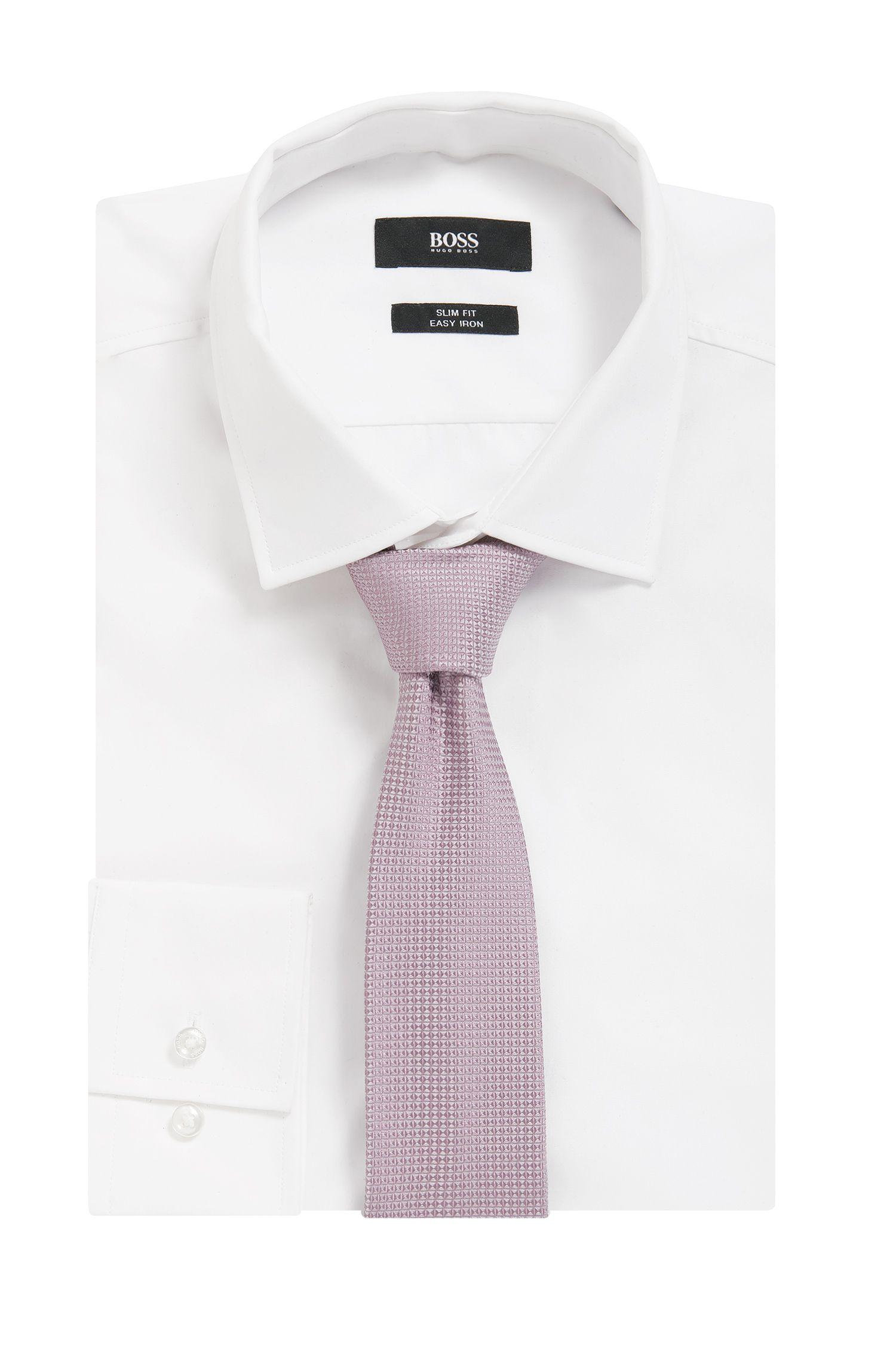 Corbata confeccionada en Italia en jacquard de seda con estampado