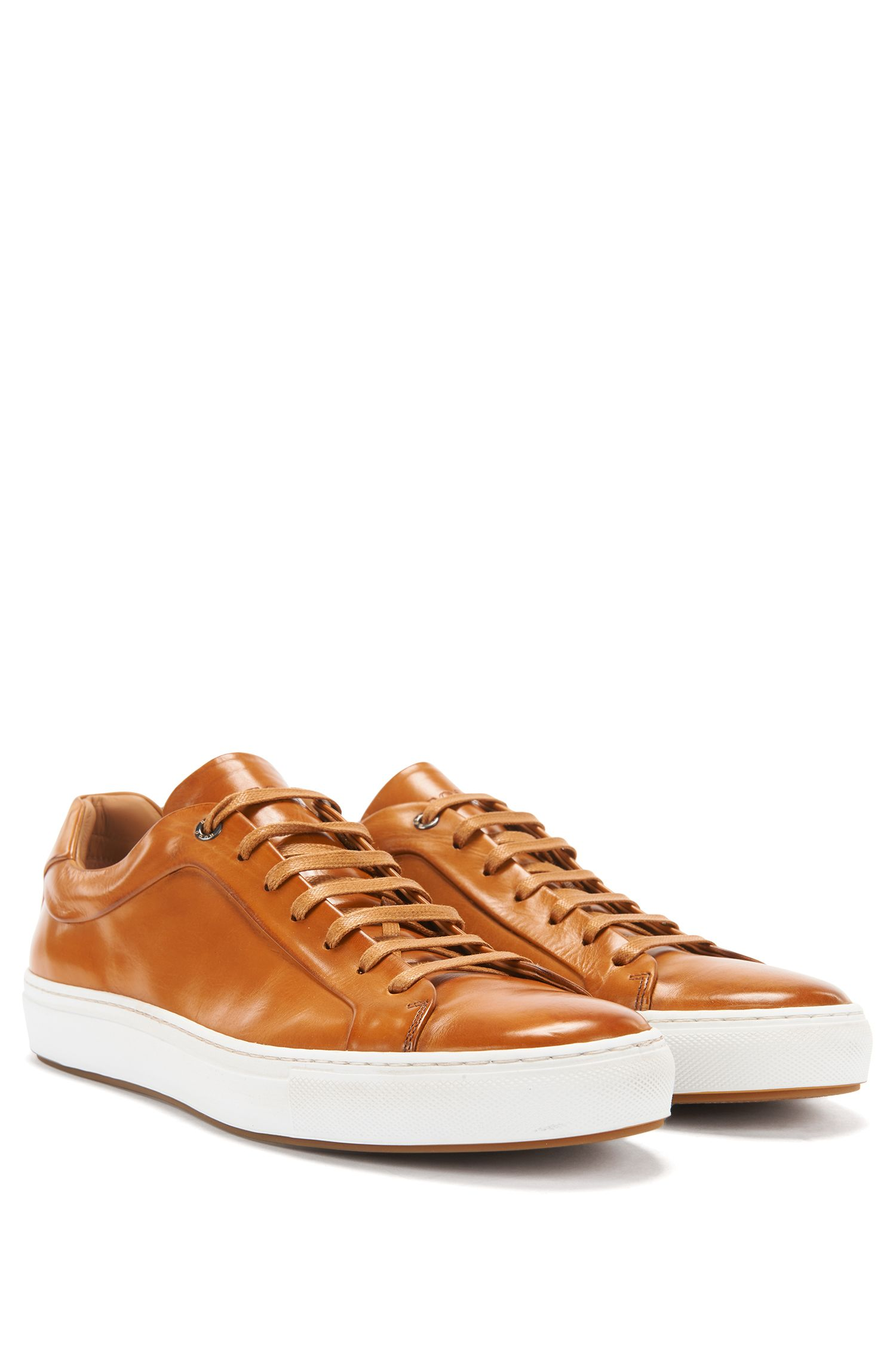 Tennis-style trainers in burnished leather
