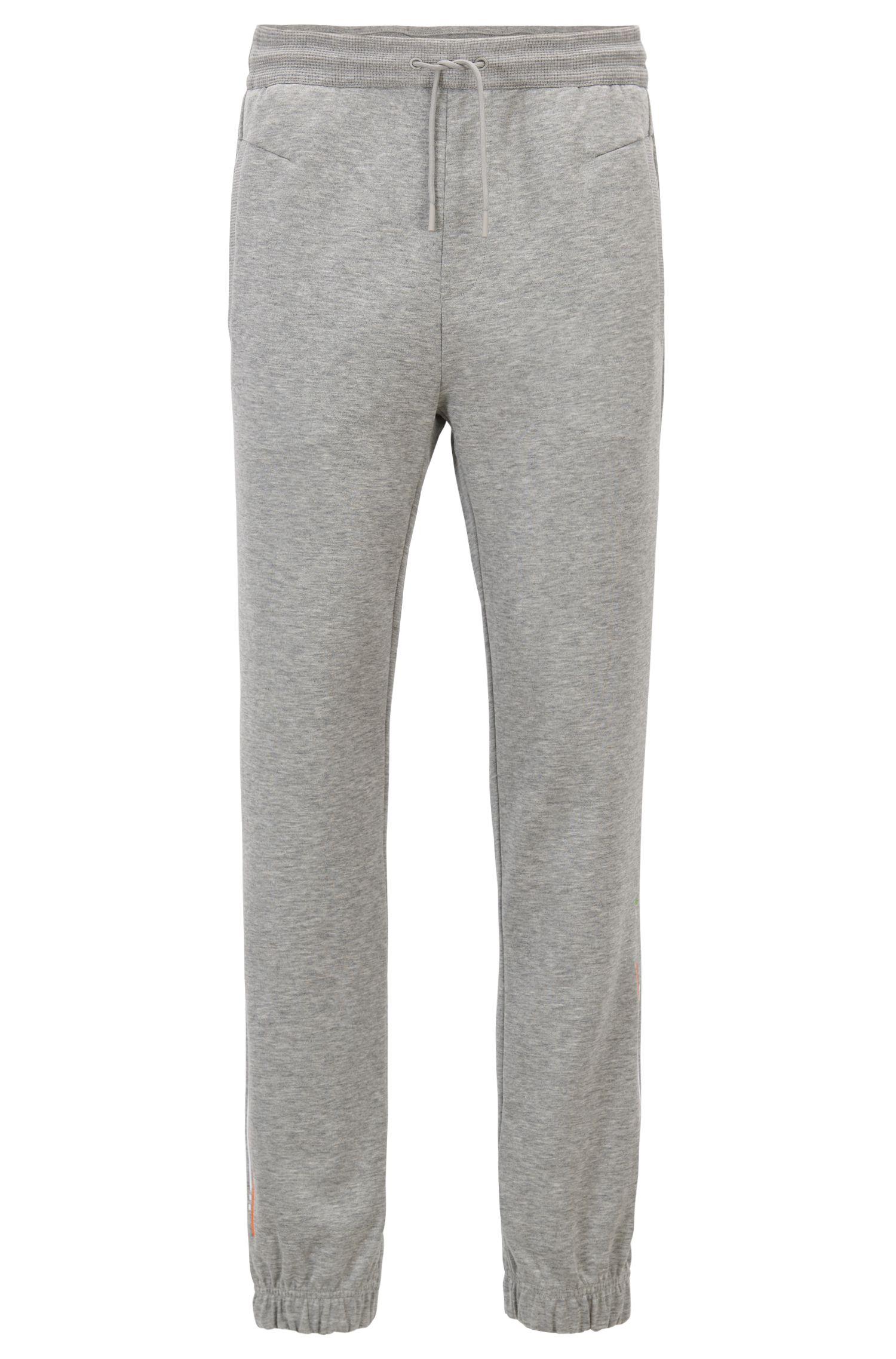 Pantalones de chándal slim fit con puños y raya bordada, Gris claro