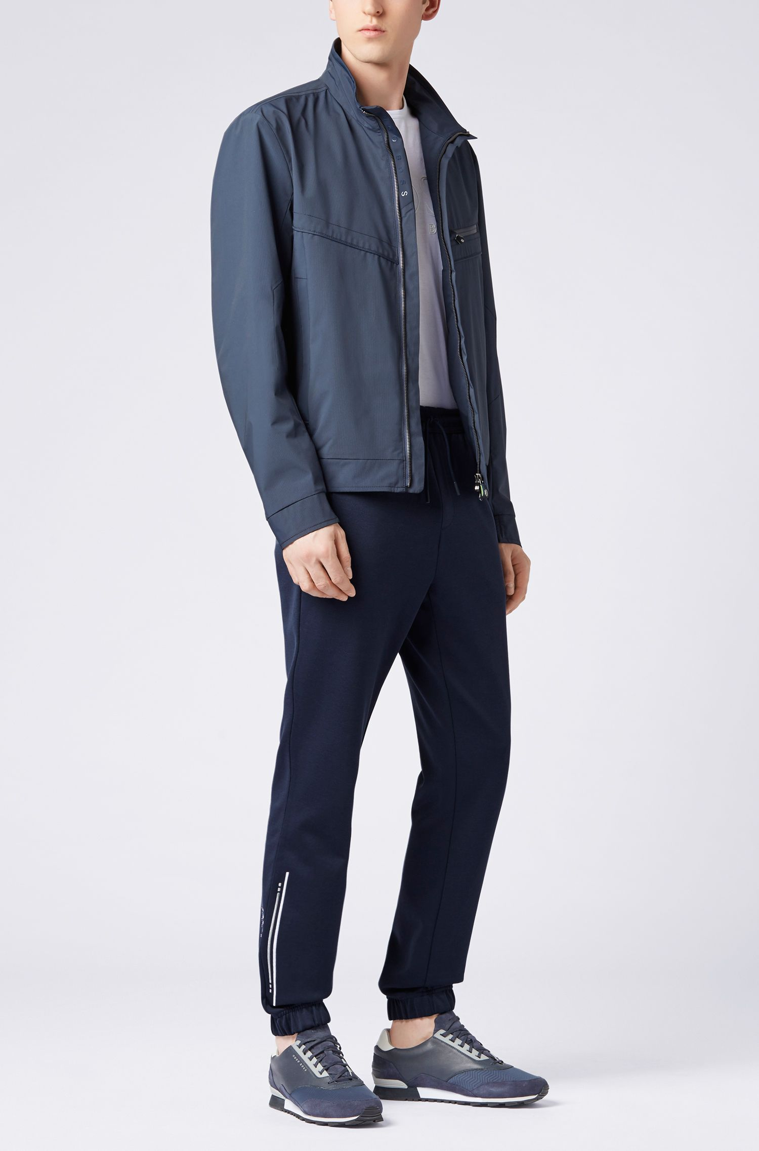 Cuffed slim-fit jogging bottoms with embroidered stripe, Dark Blue