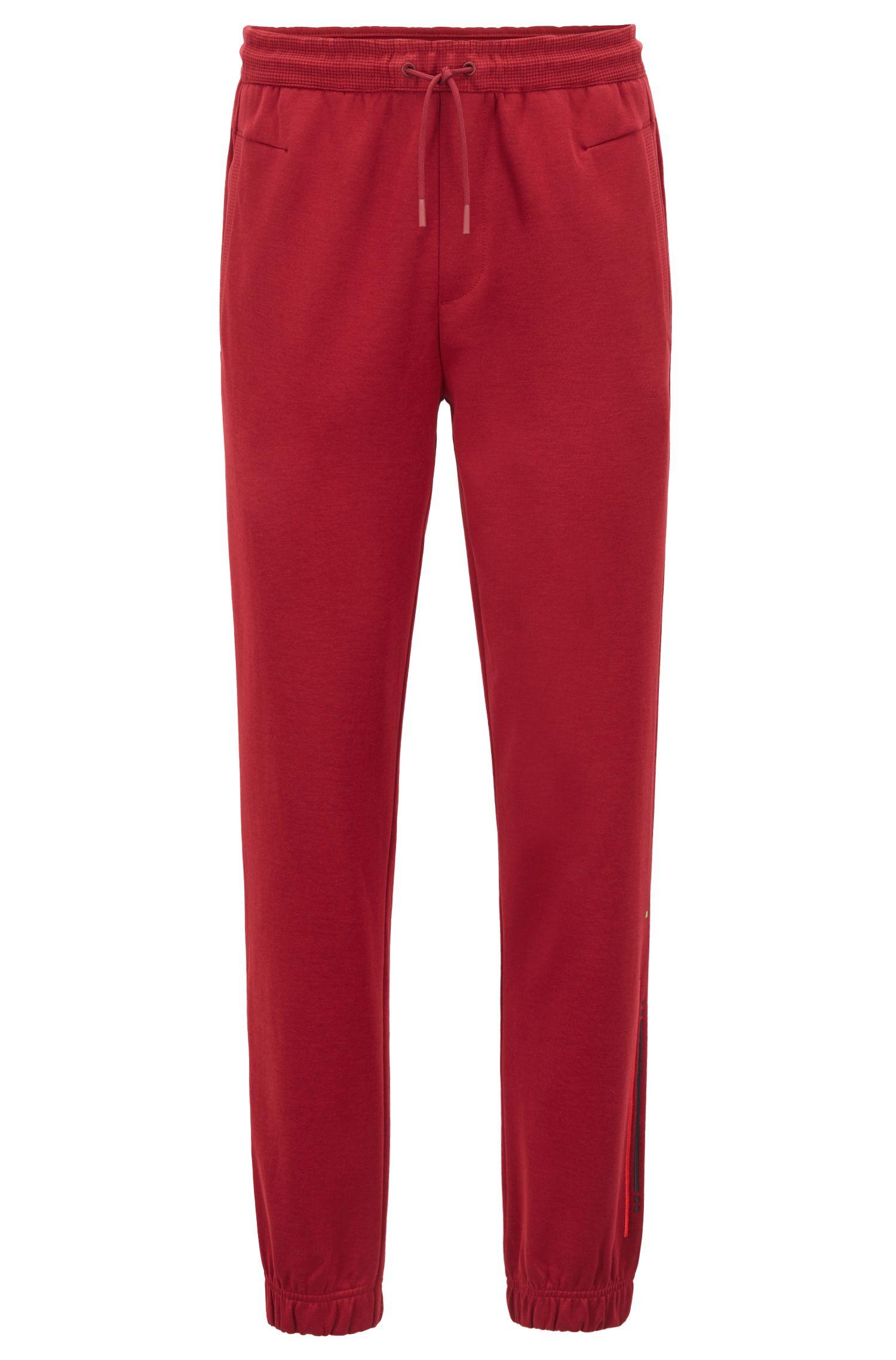 Pantalones de chándal slim fit con puños y raya bordada, Rojo oscuro