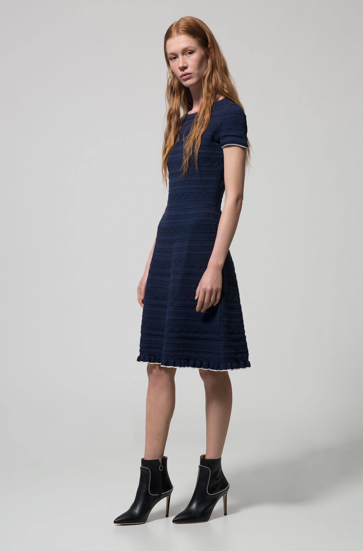 Knitted flared dress with three-dimensional structure