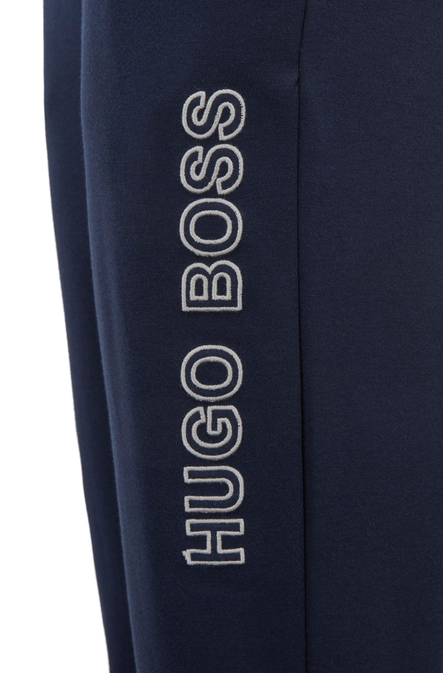 Jogginghose aus Baumwolle mit Bündchen und Kontrast-Details, Dunkelblau