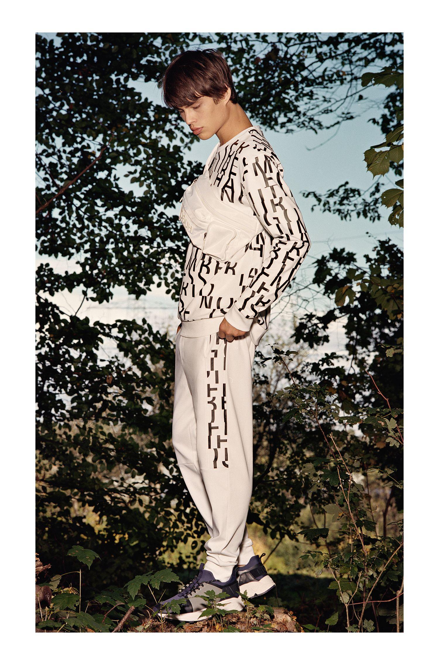 Oversized-fit sweater van zuivere katoen met abstracte slogan, Wit