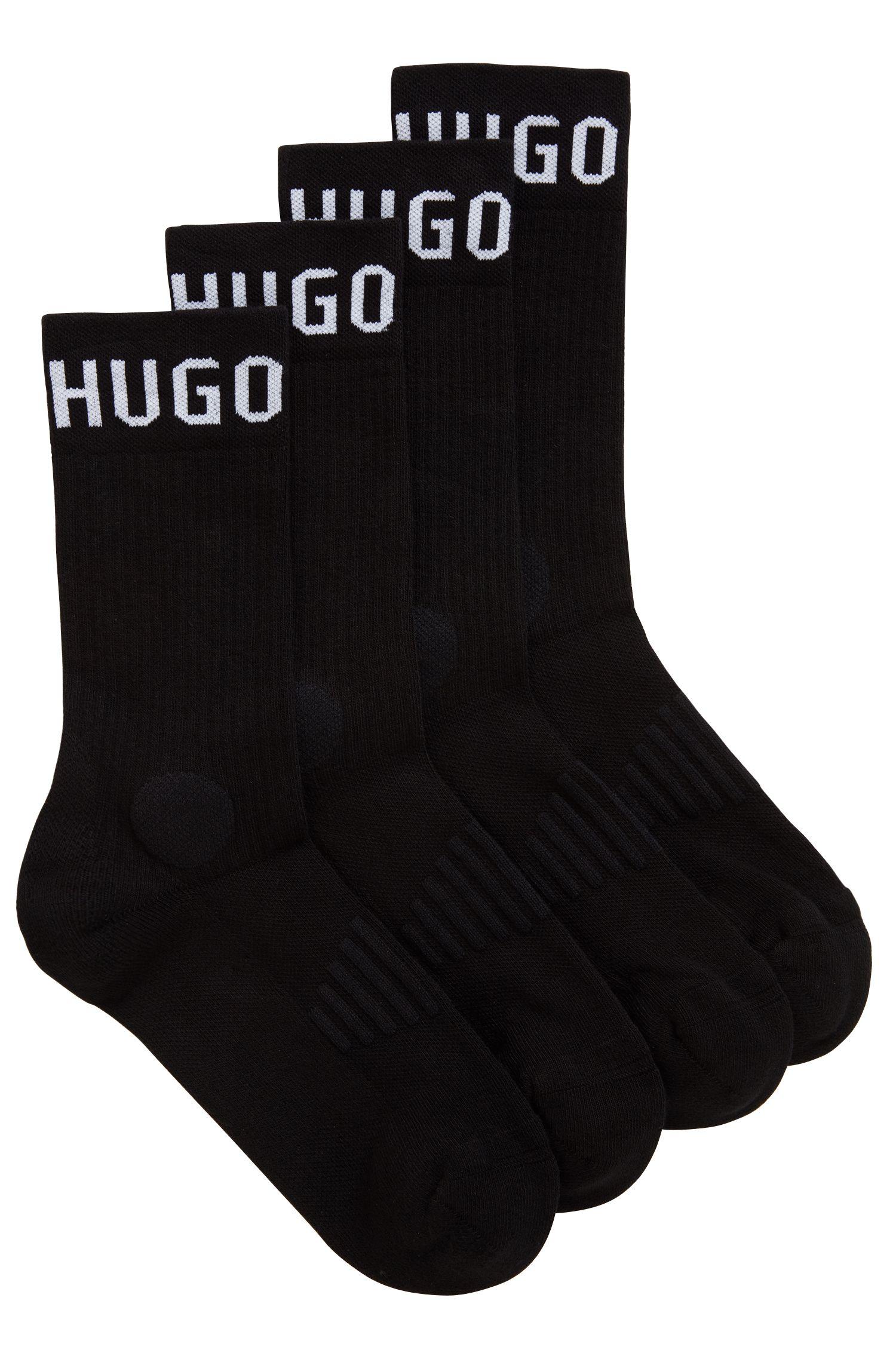 Un paquete doble de calcetines deportivos de largo normal con acolchado